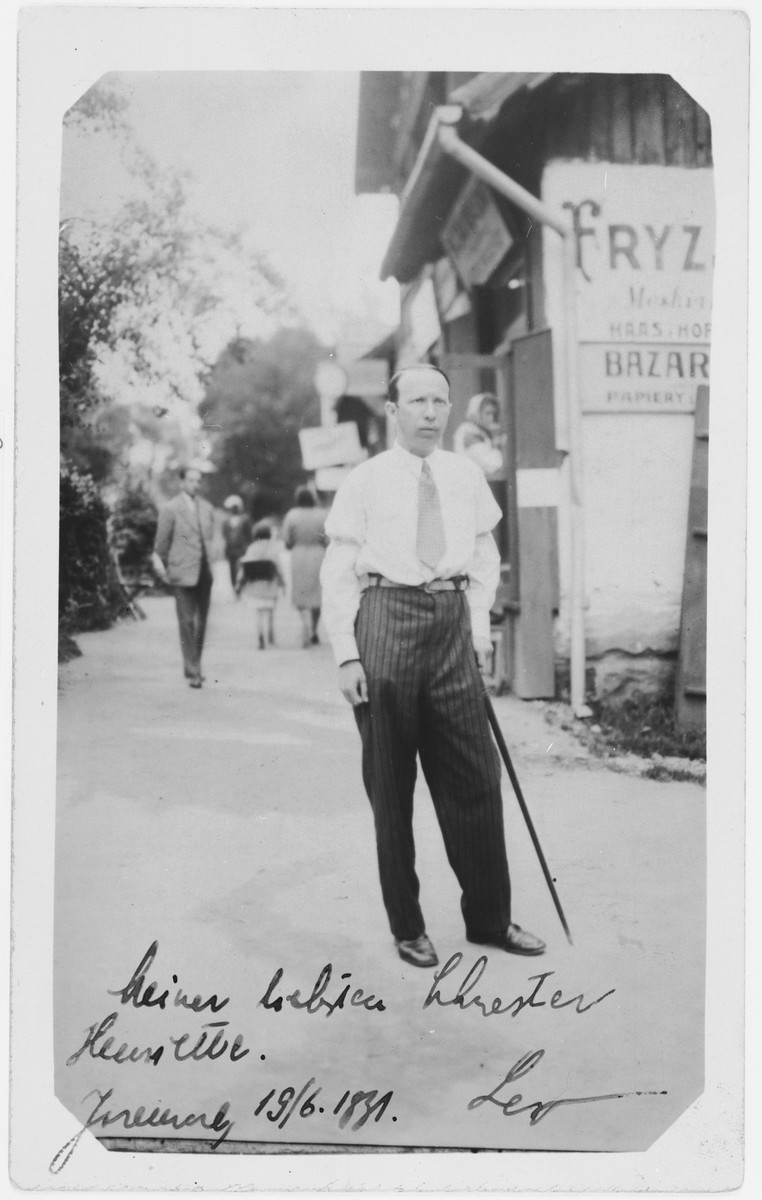 Leon Reichman stands outside his father's barber shop in Tluste.