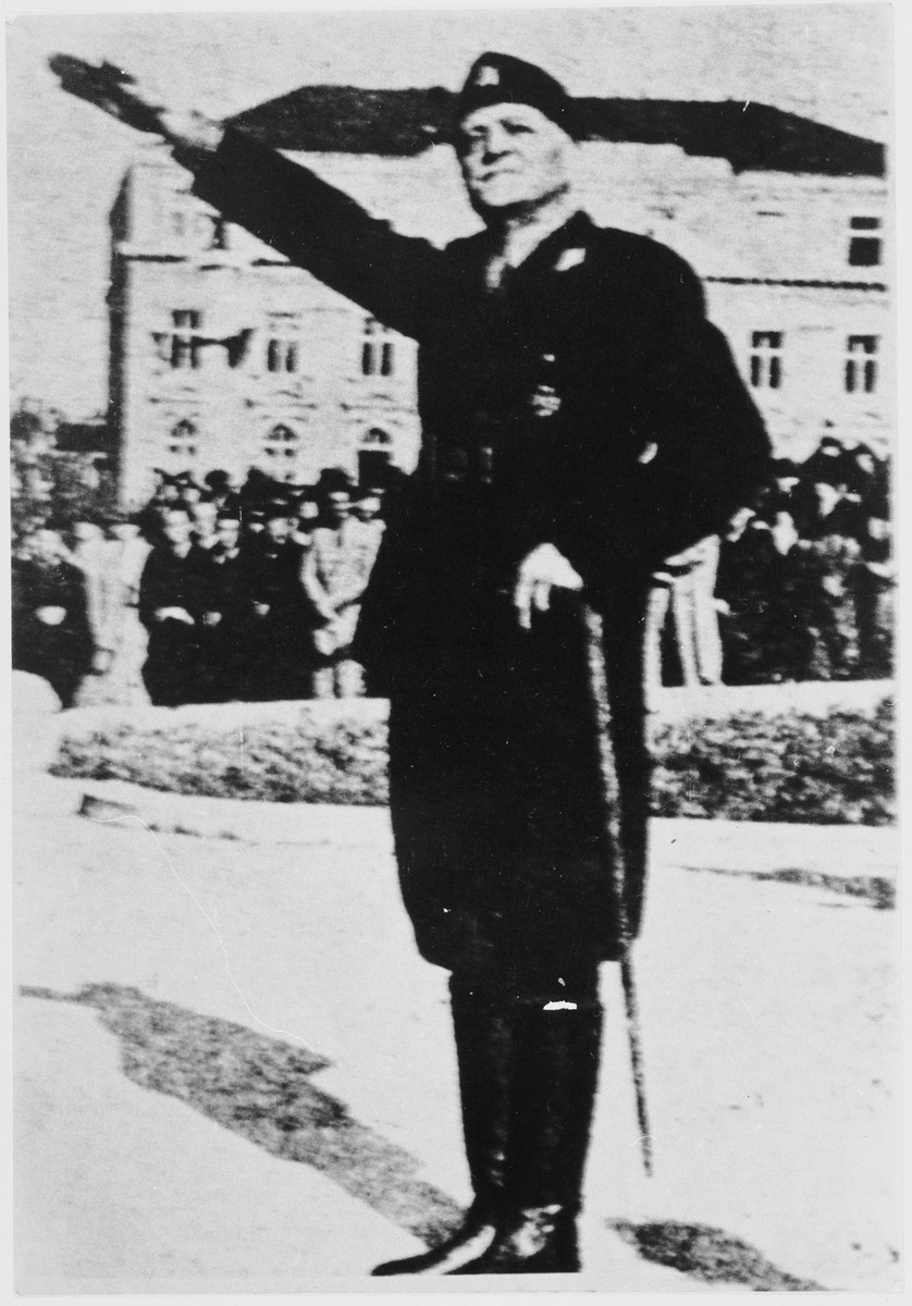Portrait of Slavko Kvaternik, Commander in Chief of the military of the Independent State of Croatia, saluting during an outdoor ceremony.