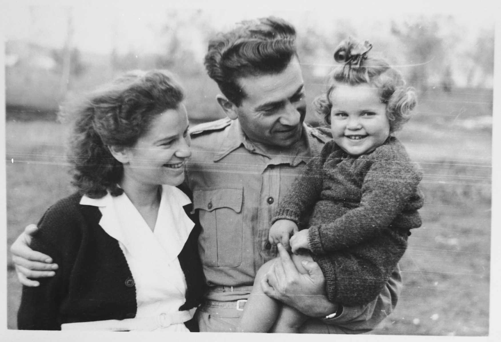 Mordechai and Ursula Tenenbaum pose with their daughter Katja in the Cinecitta displaced persons camp.