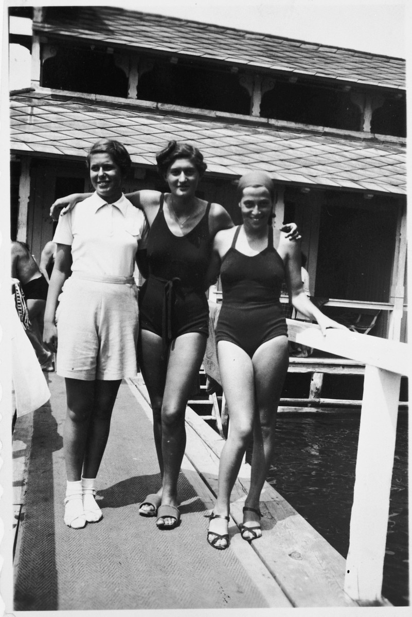 Three Austrian Jewish swimming champions pose outside the swimming area where they are training.  Pictured from left to right are: Judith Deutsch, Ruth Langer and Lucie Goldner.
