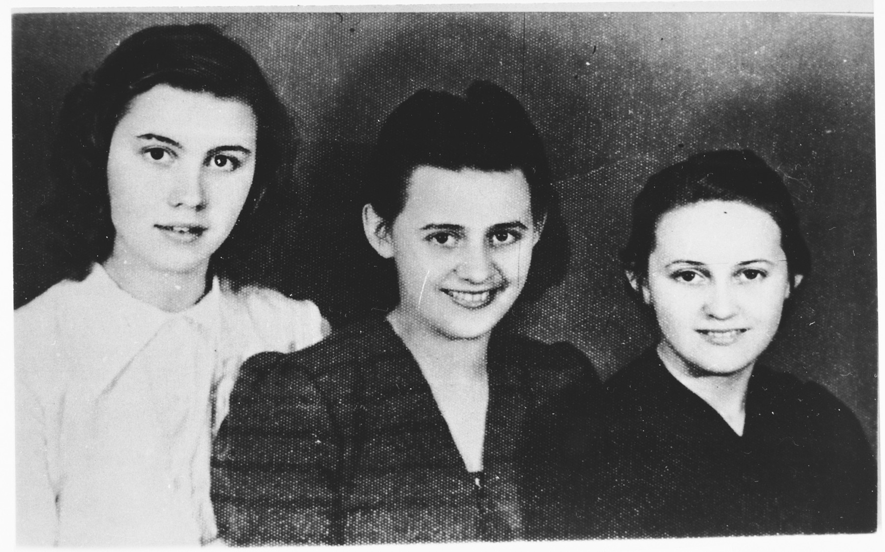 Studio portrait of the Ditrik sisters from Zenica, Bosnia, [possibly members of the Yugoslav resistance] who were deported to Jasenovac on December 16, 1944.    Pictured from left to right are: Borka (18), Angelina (20), and Miroslava (16).  They were killed in Ustice, where the Una River meets the Sava River.