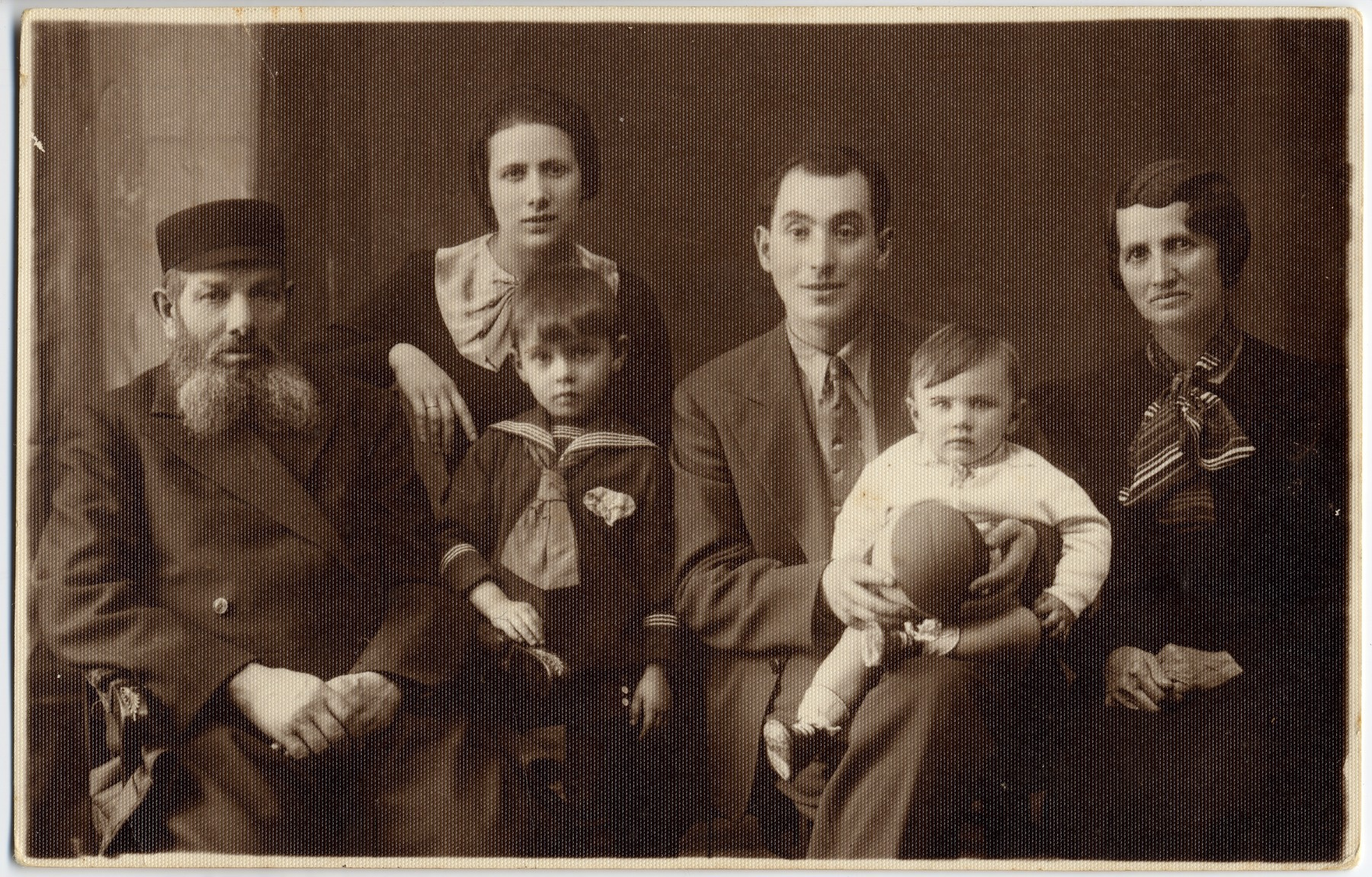 Studio portrait of a Jewish familiy in prewar Poland.   Pictured are members of the Berlinska or Fajtlowicz family.