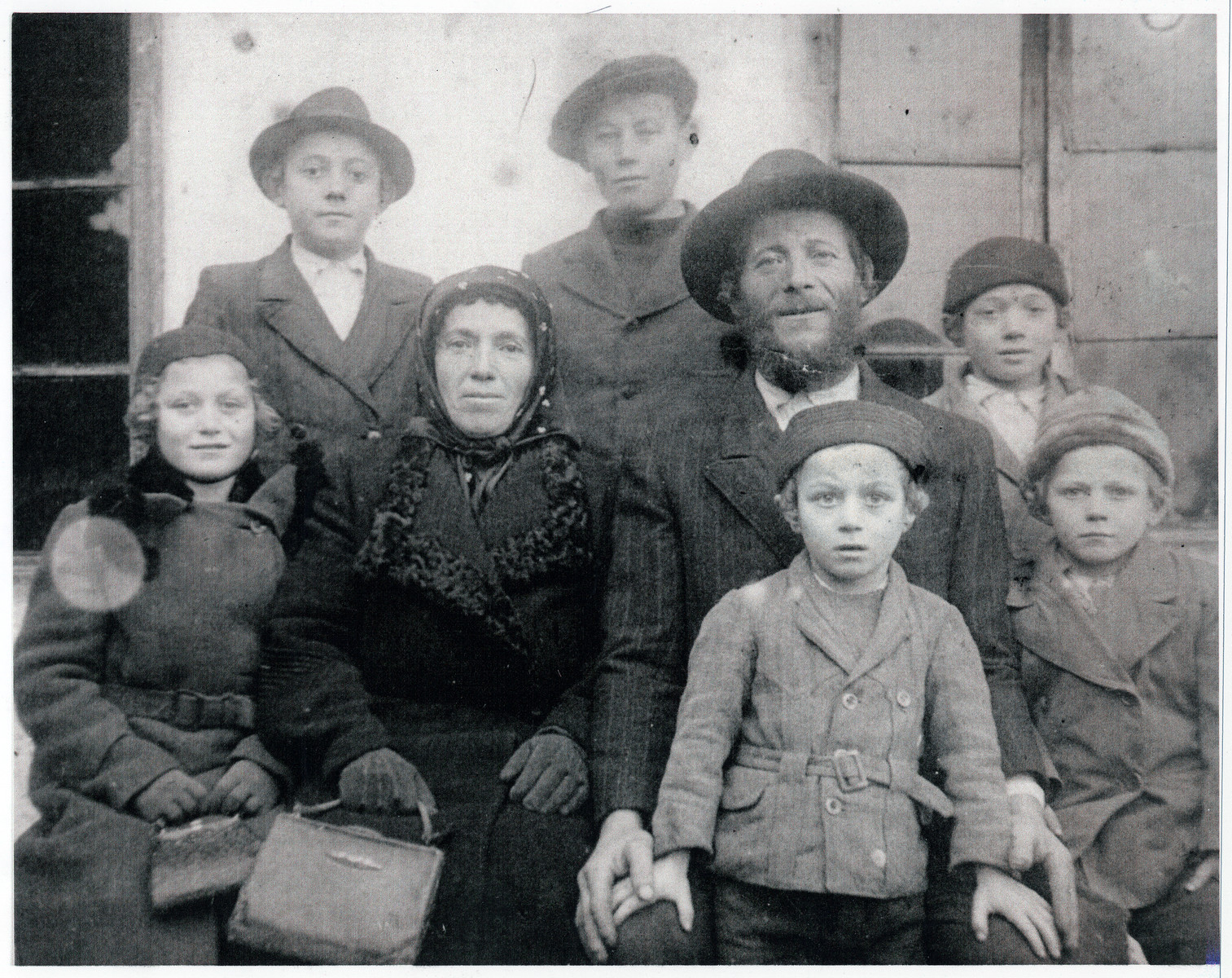 """Portrait of a religious Transcarpathian Jewish farmer, his wife and six of his children.  The farmer, Chaim Simcha Mechlowitz, became immortalized as the farmer in Roman Vishniac's collection """"A Vanished World."""""""