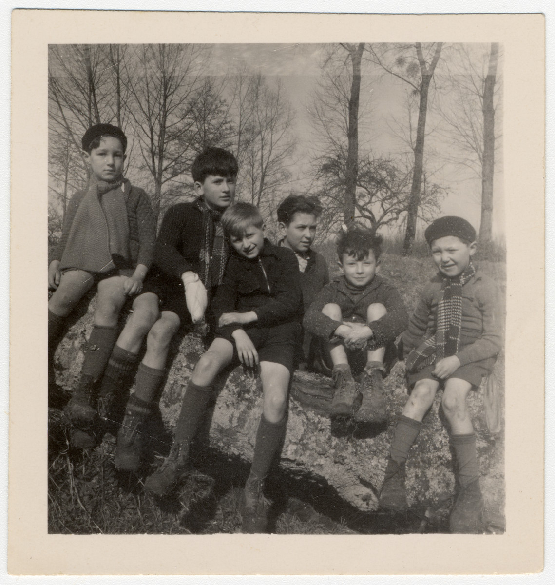 A group of Jewish children evacuated from Paris by the Quakers, outside of the Quaker boarding home, Moulin de la Ferriere, in Noce, Normandy, in early 1940. Steven Simon is the first one at left.