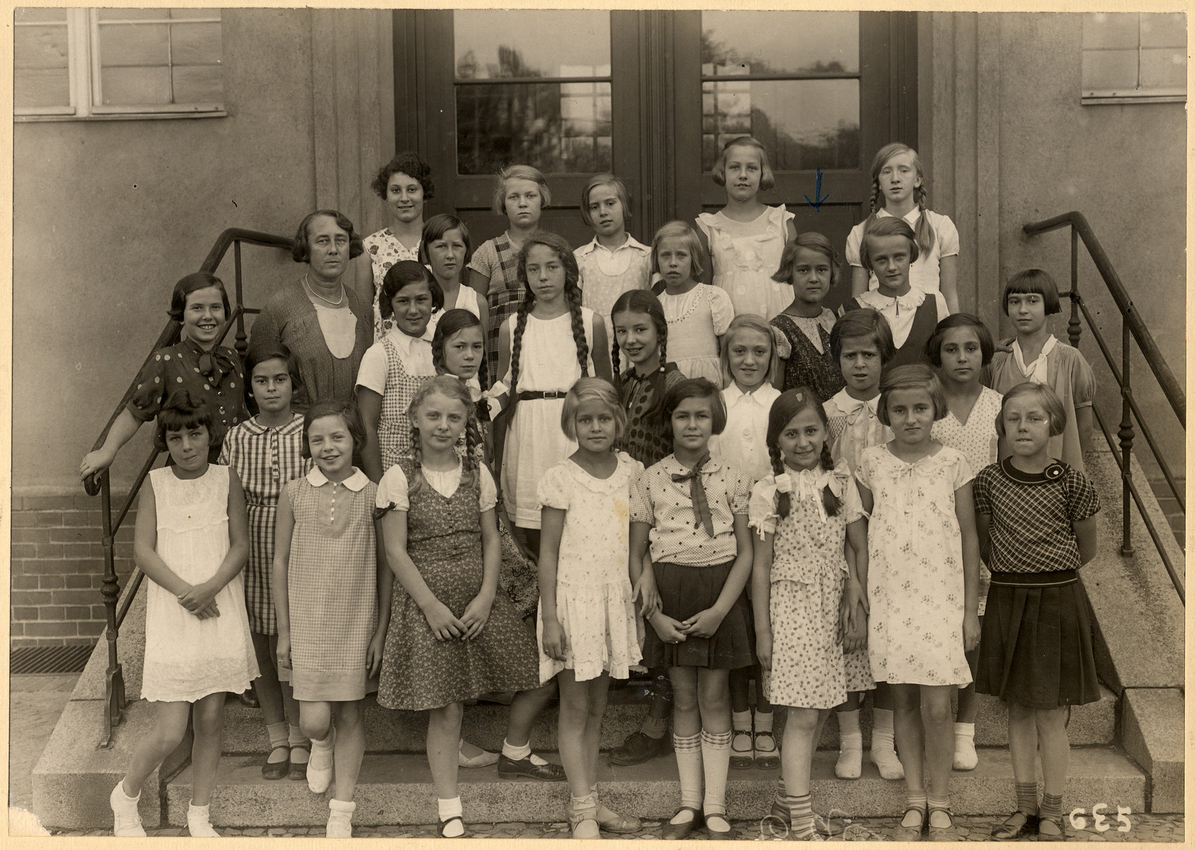 Group portrait of girls in a predominantly German school.  The Jewish students were expelled a few years later.  Among those pictured is Leonora Priwin (sister of the conductor Andre Previn) first row, second from the left; Inge Jaeger a Jewish mischlinge who identified as a Jew, standing second row from the top, second from the left; Marion Sauerbrunn, the donor, to the right of the teacher in the second row.