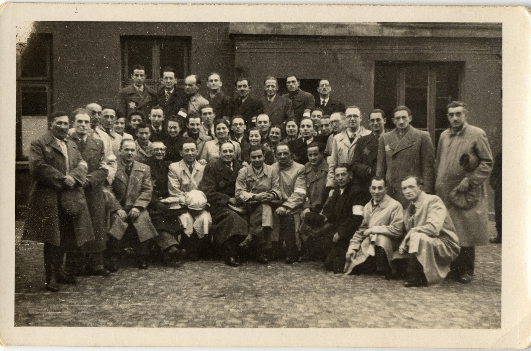Group portrait of the employees of the leather workshop in the Lodz ghetto.  Among those pictured is Leon Fajtlowicz (third from right in the second row from the bottom).  He was the uncle of the donor and in charge of all the leather workshops in the ghetto.