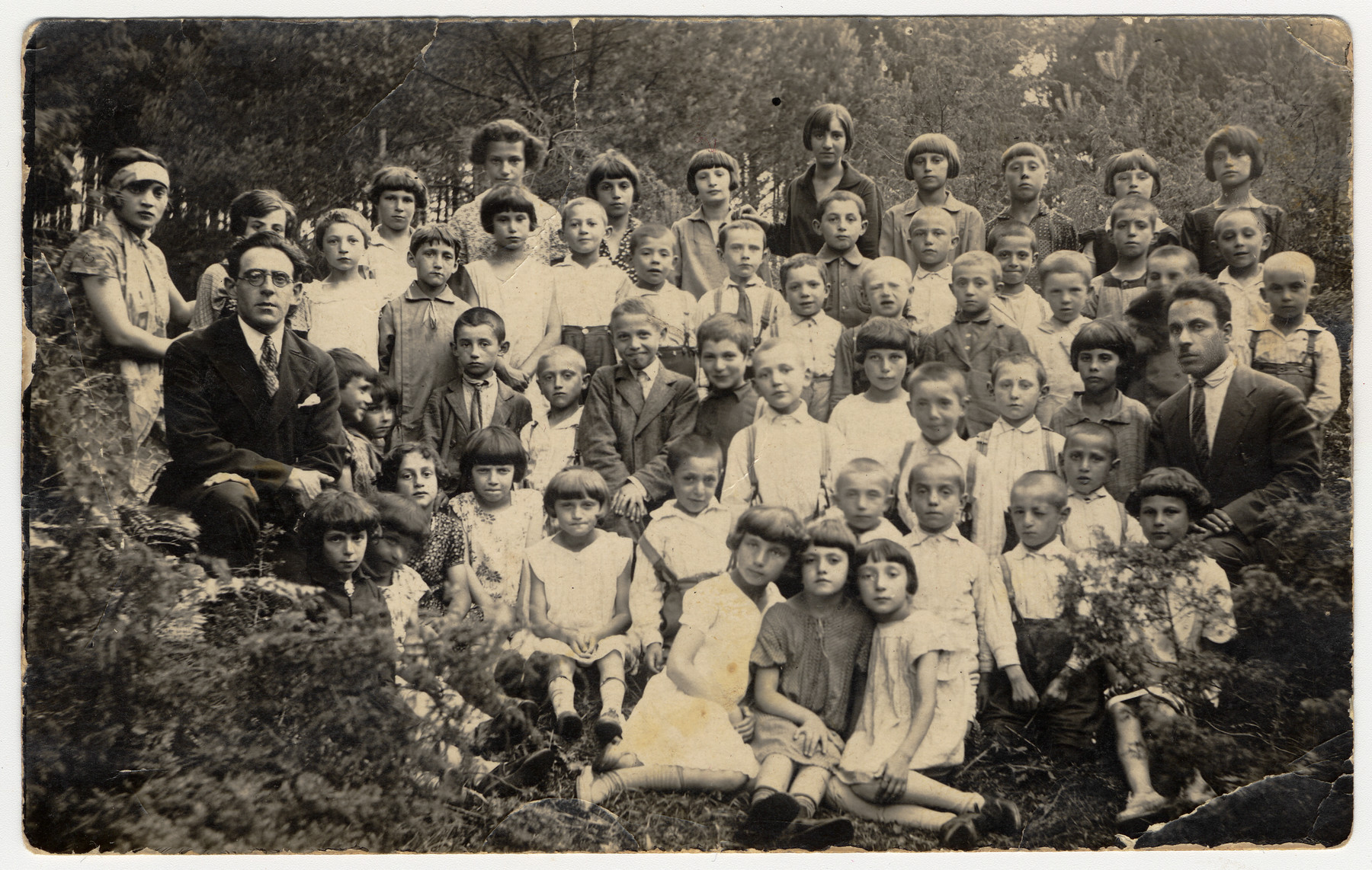 Group portrait of the children and teachers of a Jewish school in Traby.  Among those pictured is Izhak Kozlowsky, the Hebrew teacher, on the far left.