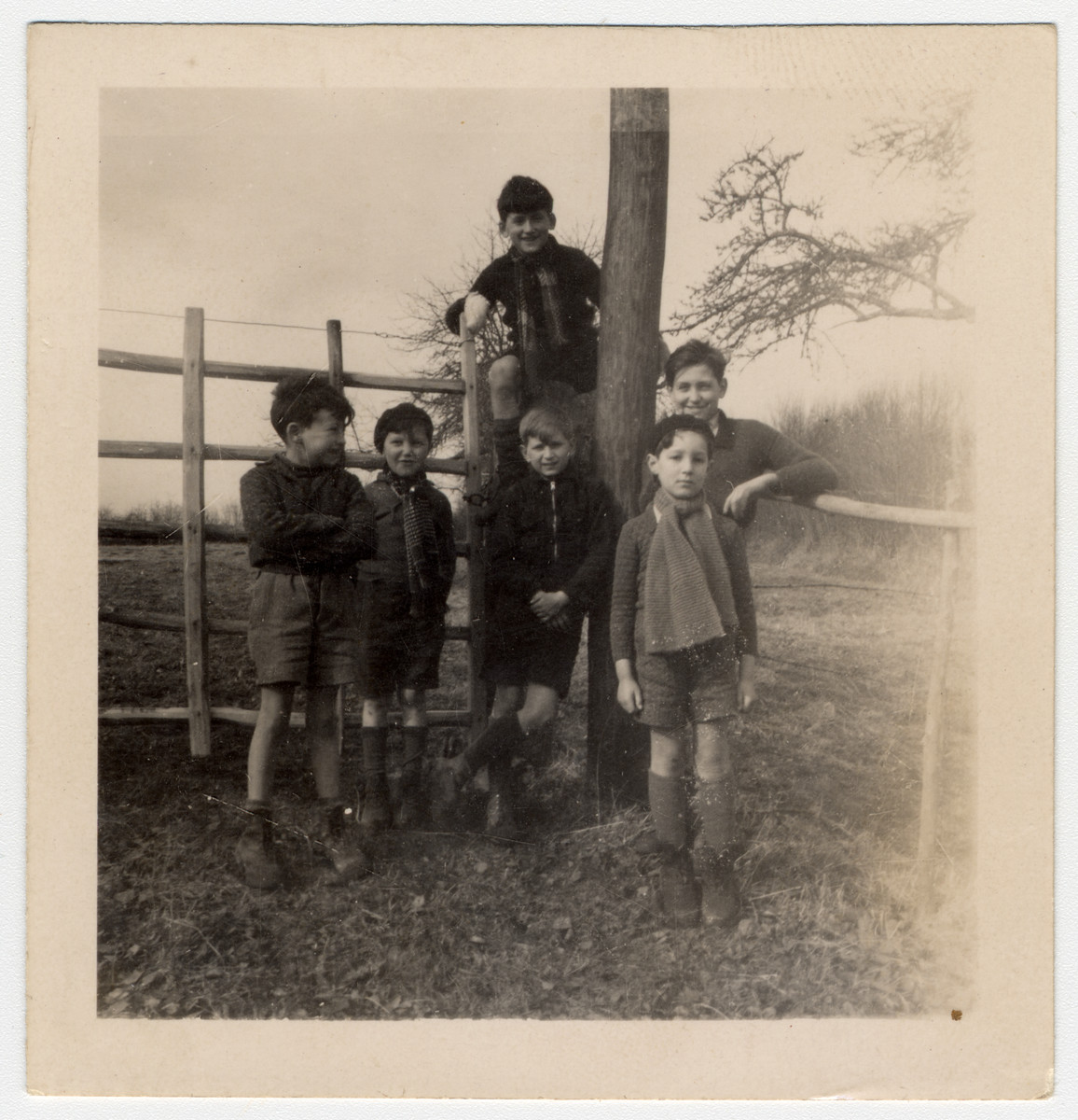 Jewish children evacuated from Paris by the Quakers to escape the bombing pose outside of a Quaker boarding  home, Moulin de la Ferriere, in Noce, Normandy in 1940. Steven Simon is in front on the right.