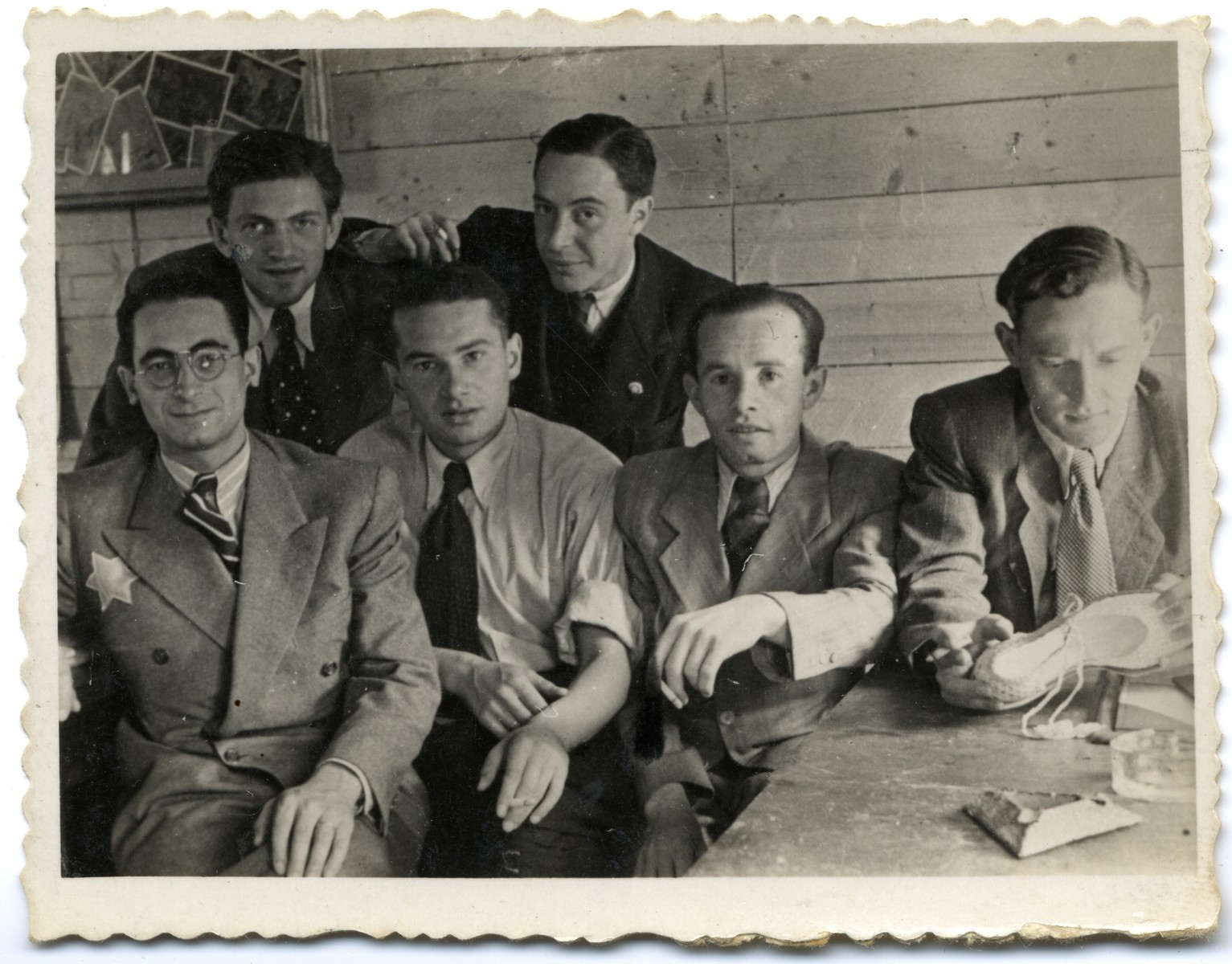 Group portrait of employees of the leather workshop in the Lodz ghetto.  Among those pictured is Leon Fajtlowicz (front, left).  He was the uncle of the donor and in charge of all the leather workshops in the ghetto.