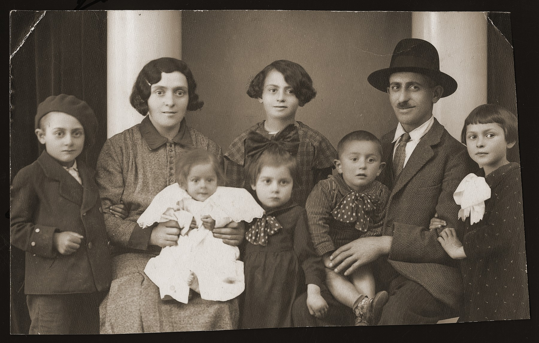 Portrait of the Guttman family soon after their move to Budapest.  Pictured are Sandor and Berta Guttman with their children Moncy, Emma, Ettel, Shimon, Miklos and Bela.