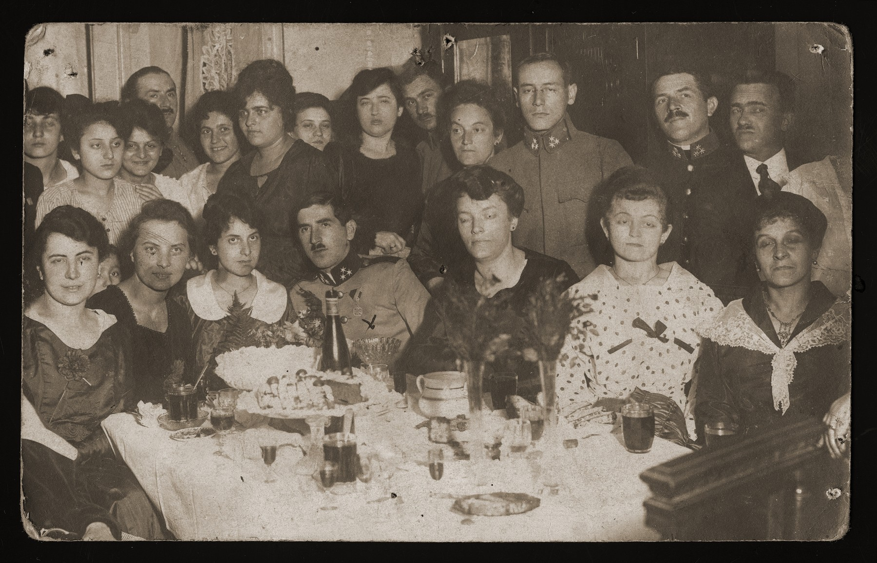 Engagement party for Adolf Gartenberg and Hania Pemstein, from Przemyl.    After their marriage they established a photo shop in Przemyl.  They later returned to Drohobycz and were killed during the Holocaust.