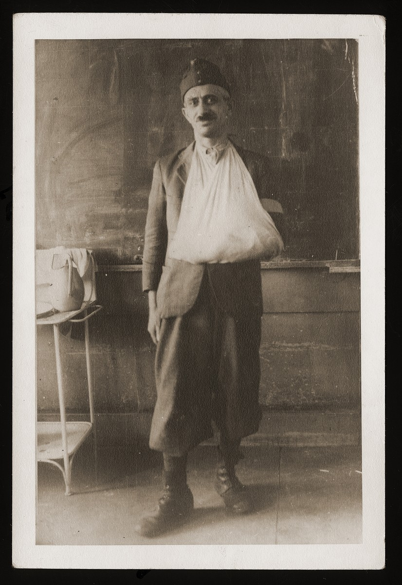 Portrait of Sandor Guttman in the uniform of a Hungarian labor battalion with his arm in a sling.