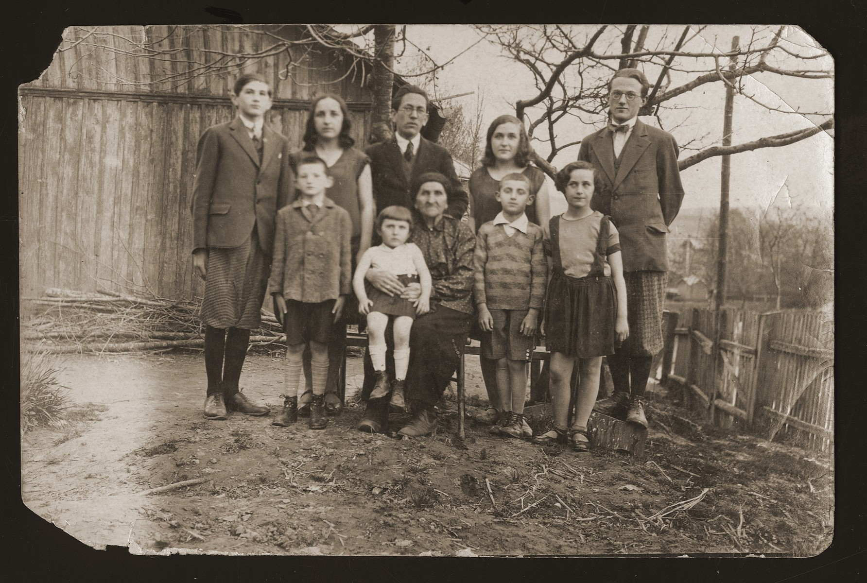 Family portrait of the Gartenberg family in Drohobycz, all of whom later perished in the Holocaust.  Top row: Julius Gartenberg, Anna Fern, Bernard Klinger, Ona Fern and Izador Gartenberg.  Lower row: Marcus Gartenberg, Hinda Gartenberg with her grandaughter Tony Schwartz on her lap, Sol Schwartz, and Ida Fern.
