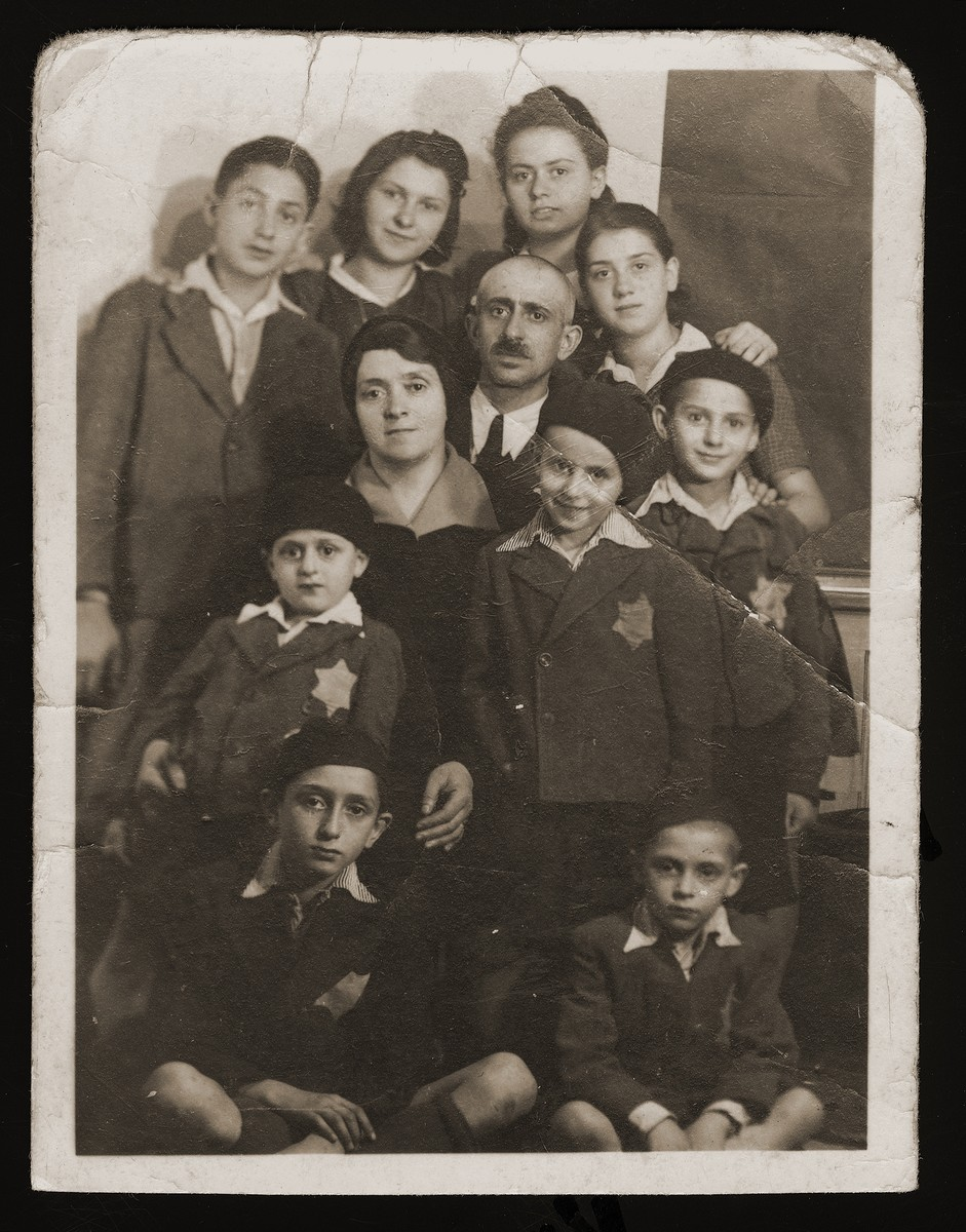 Sandor and Berta Guttman with their nine children in a safe house in Budapest.