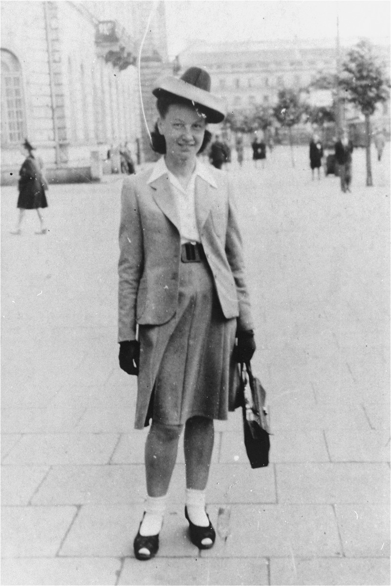"Feigele Peltel (now Vladka Meed), a courier for the Jewish underground on the ""Aryan side"" of Warsaw, poses in Theater Square (Plac Teatralny)."