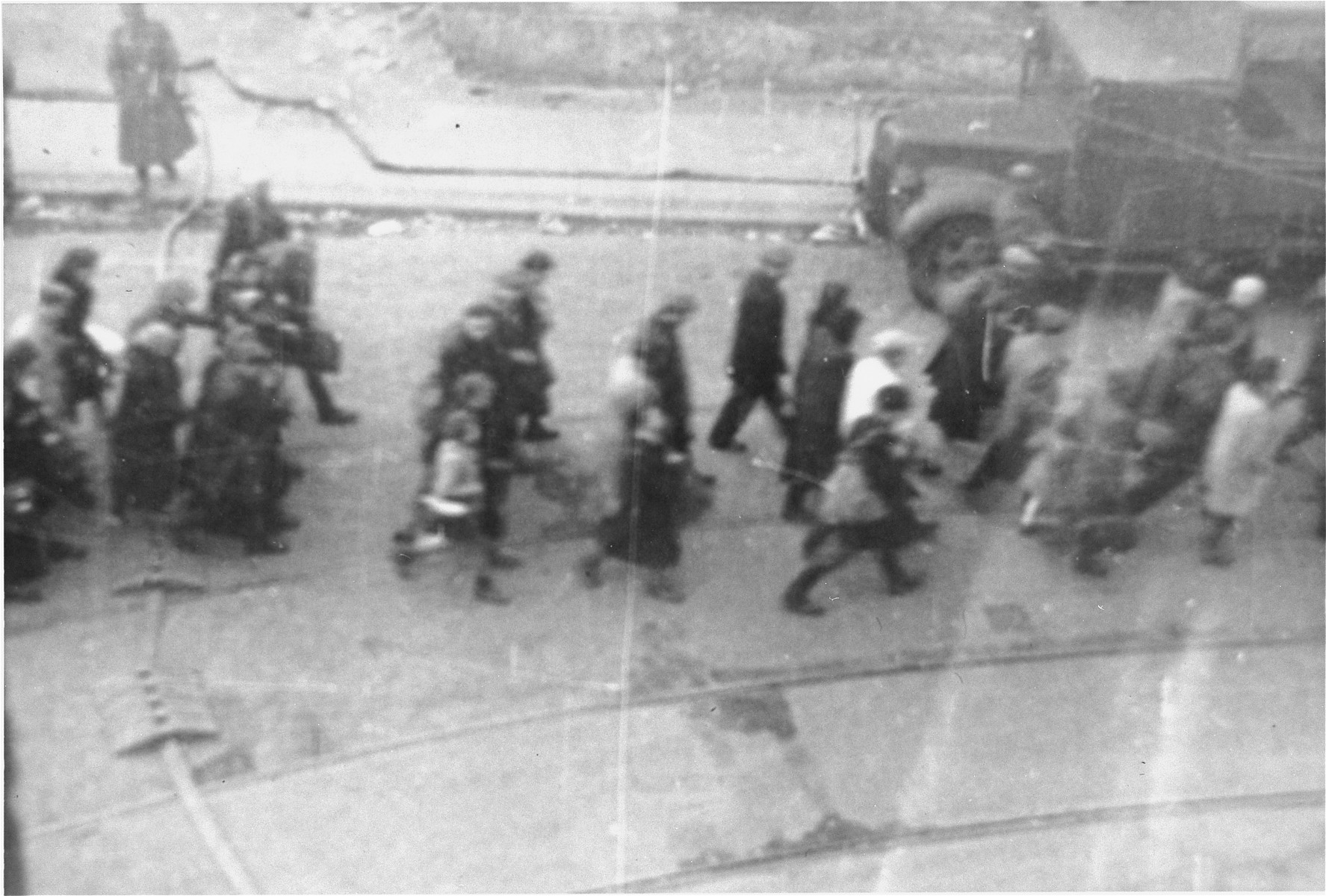 Jews captured by the SS during the suppression of the Warsaw ghetto uprising march down Nowolipie and Zelazna Street to the Umschlagplatz for deportation.