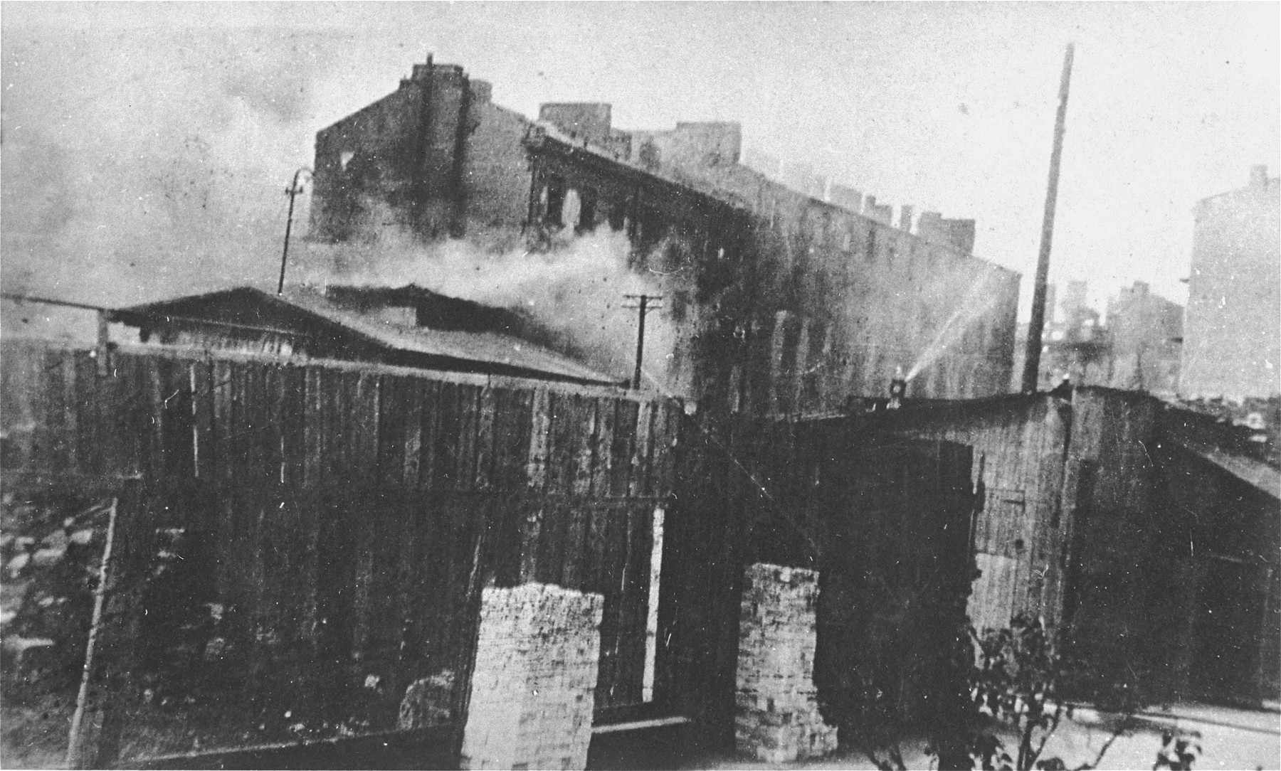 Apartment buildings burn during the suppression of the Warsaw ghetto uprising.