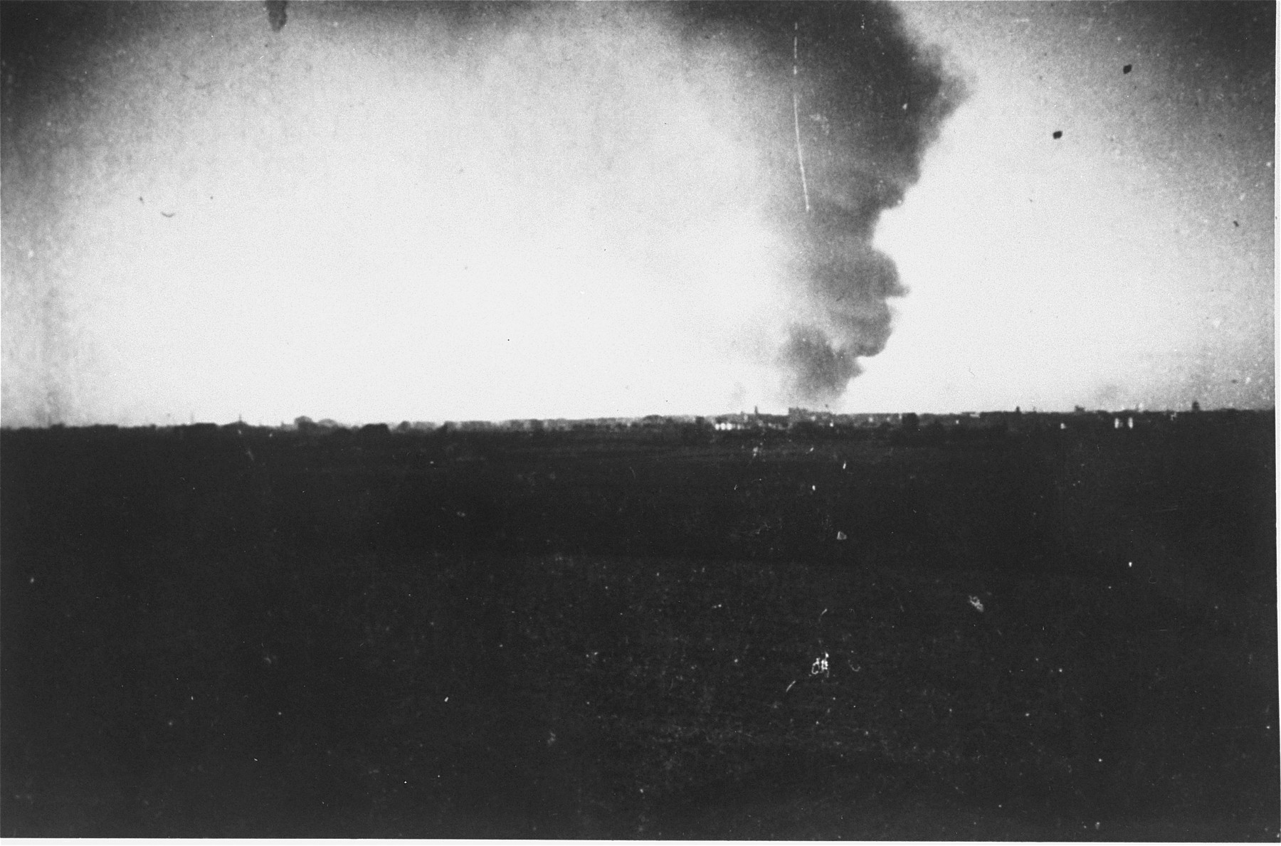Smoke rises over Warsaw from the burning ghetto.  The view is from the neighborhood of Kolo.