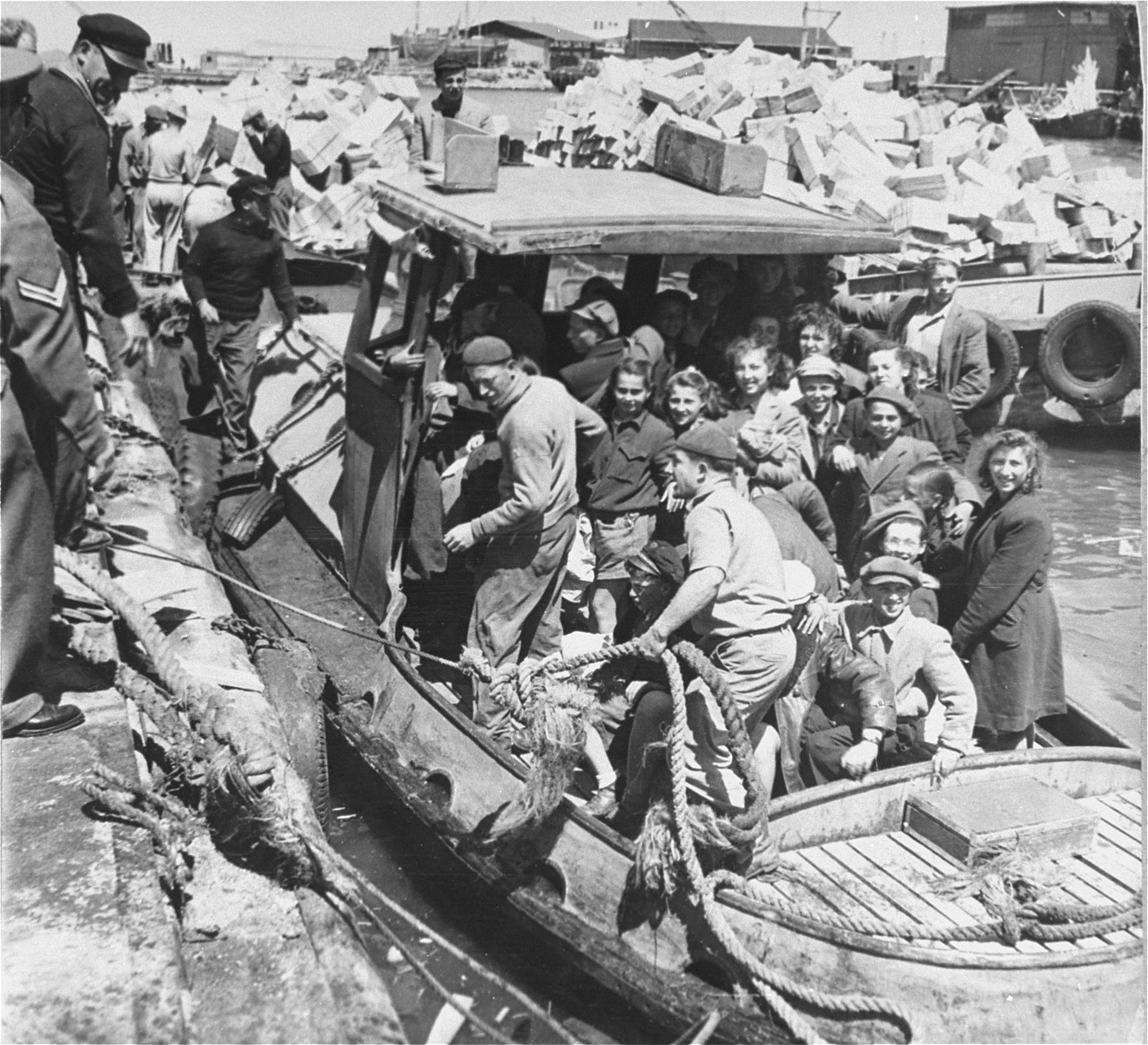 A group of children survivors from the Bergen-Belsen displaced persons' camp are brought to shore in Tel Aviv, after having been detained in refugee camps in Cyprus.