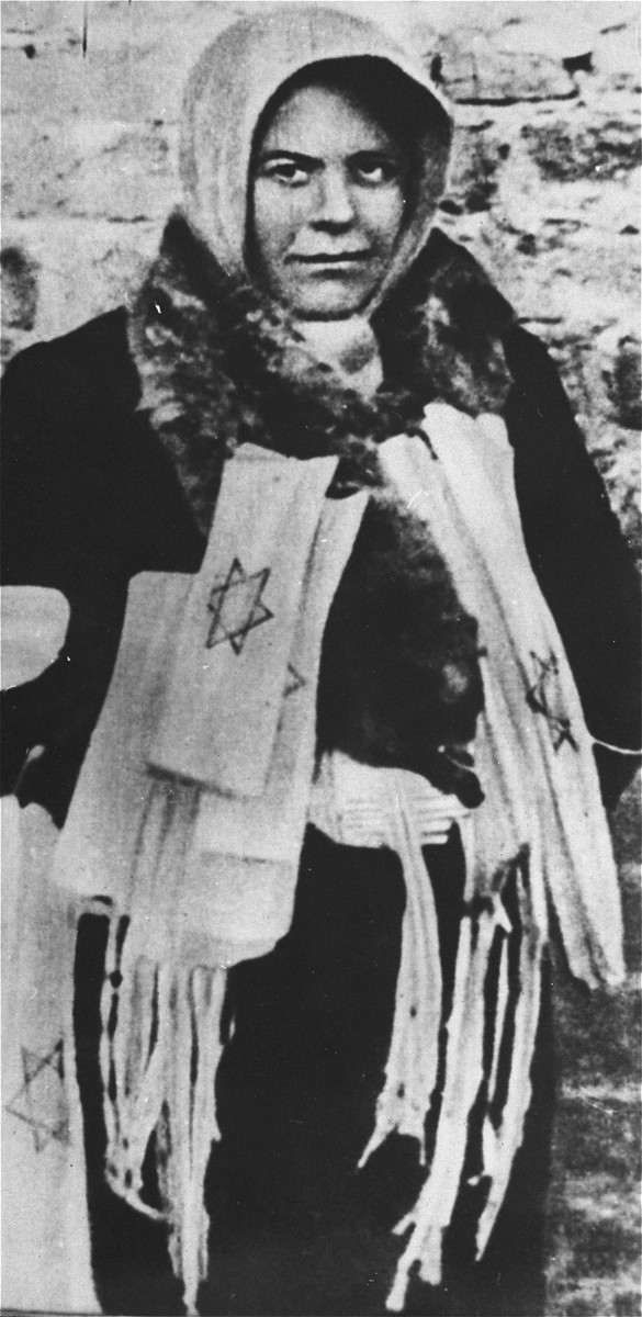 A woman selling armbands with the Star of David in the Warsaw ghetto.