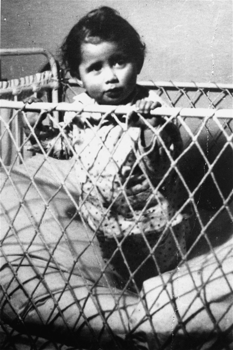 Ewa Kupferblum looks out from her crib in the Warsaw ghetto.