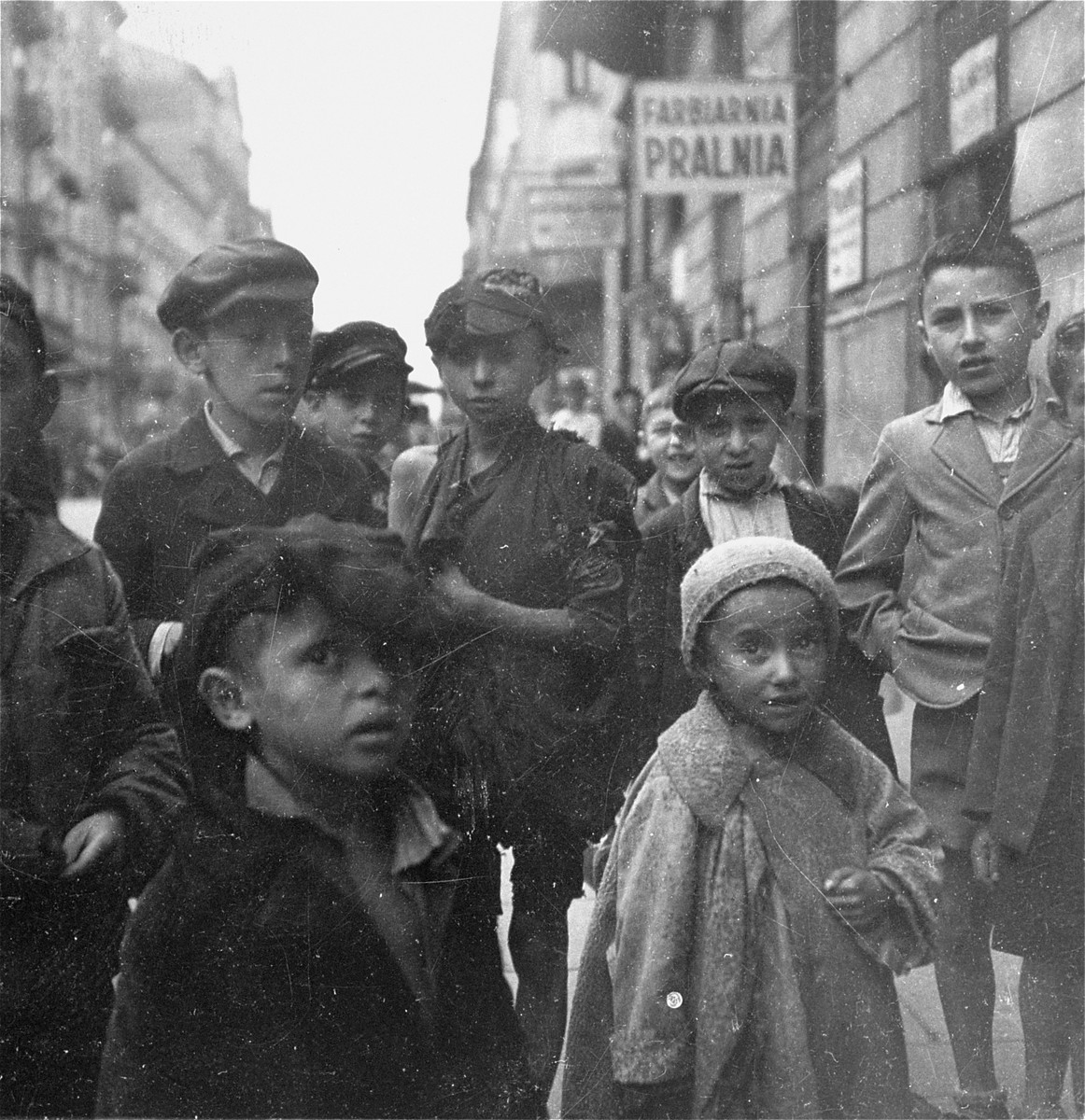"Children on the street in the Warsaw ghetto.    Joest's original caption reads: ""The hunger and misery of most of the children one saw showed more in their clothing than in their faces."""