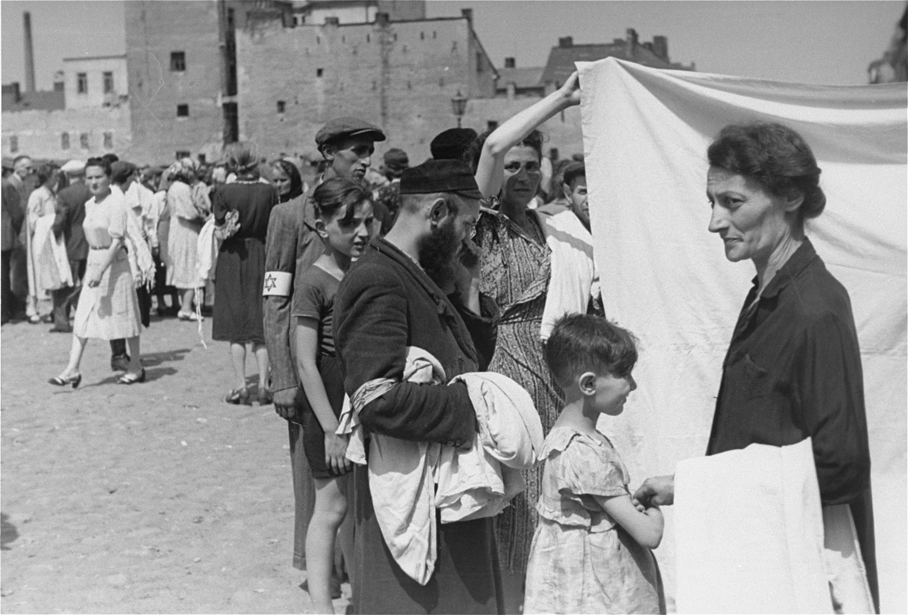 Jews shop at an open air market in the Warsaw ghetto.