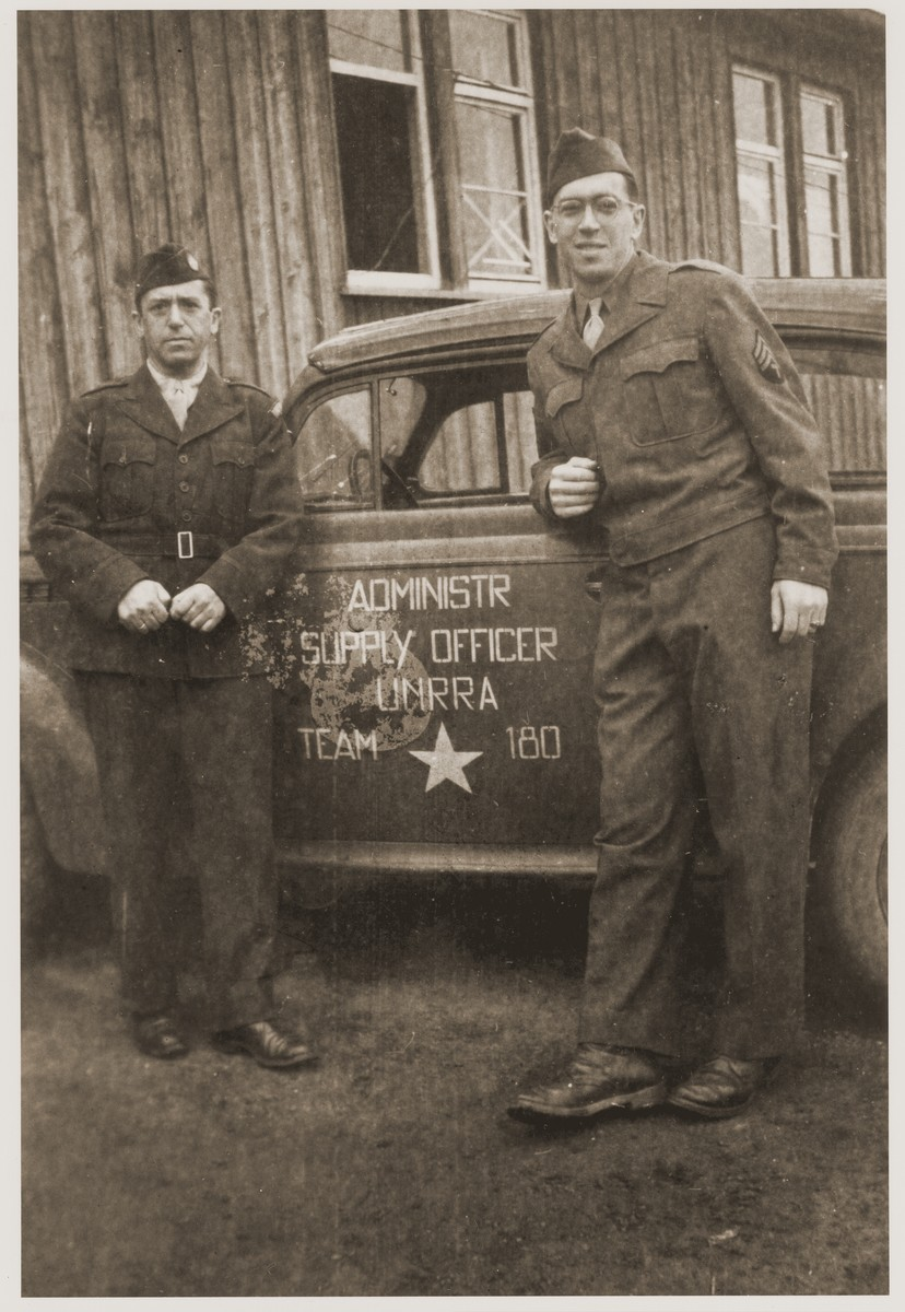 Michel Schadur (left) poses with another member of UNRRA Team 180 next to his official car.