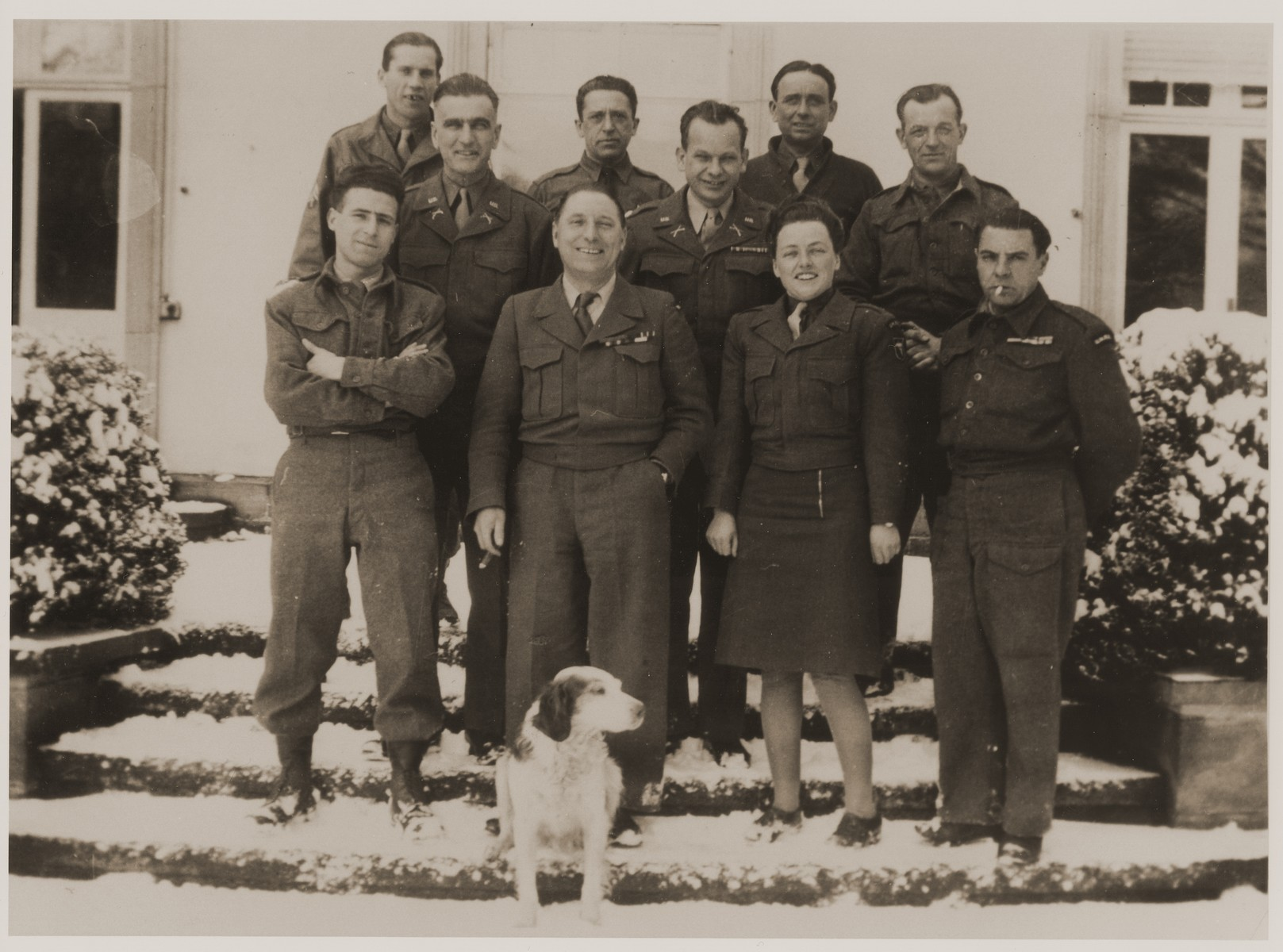 Group portrait of UNNRA officers in Wuerttemberg.  Michel Shadur is pictured in the top row, third from the left.