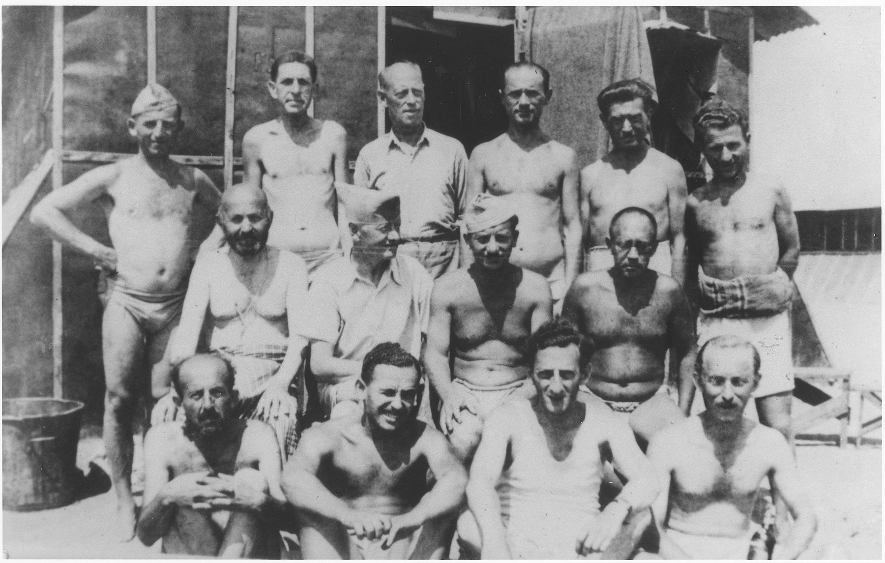 Group portrait of male prisoners at the Gurs internment camp.  Among those pictured is Rudolf Goldreich (middle row, second from the left), a former passenger on the MS St. Louis.