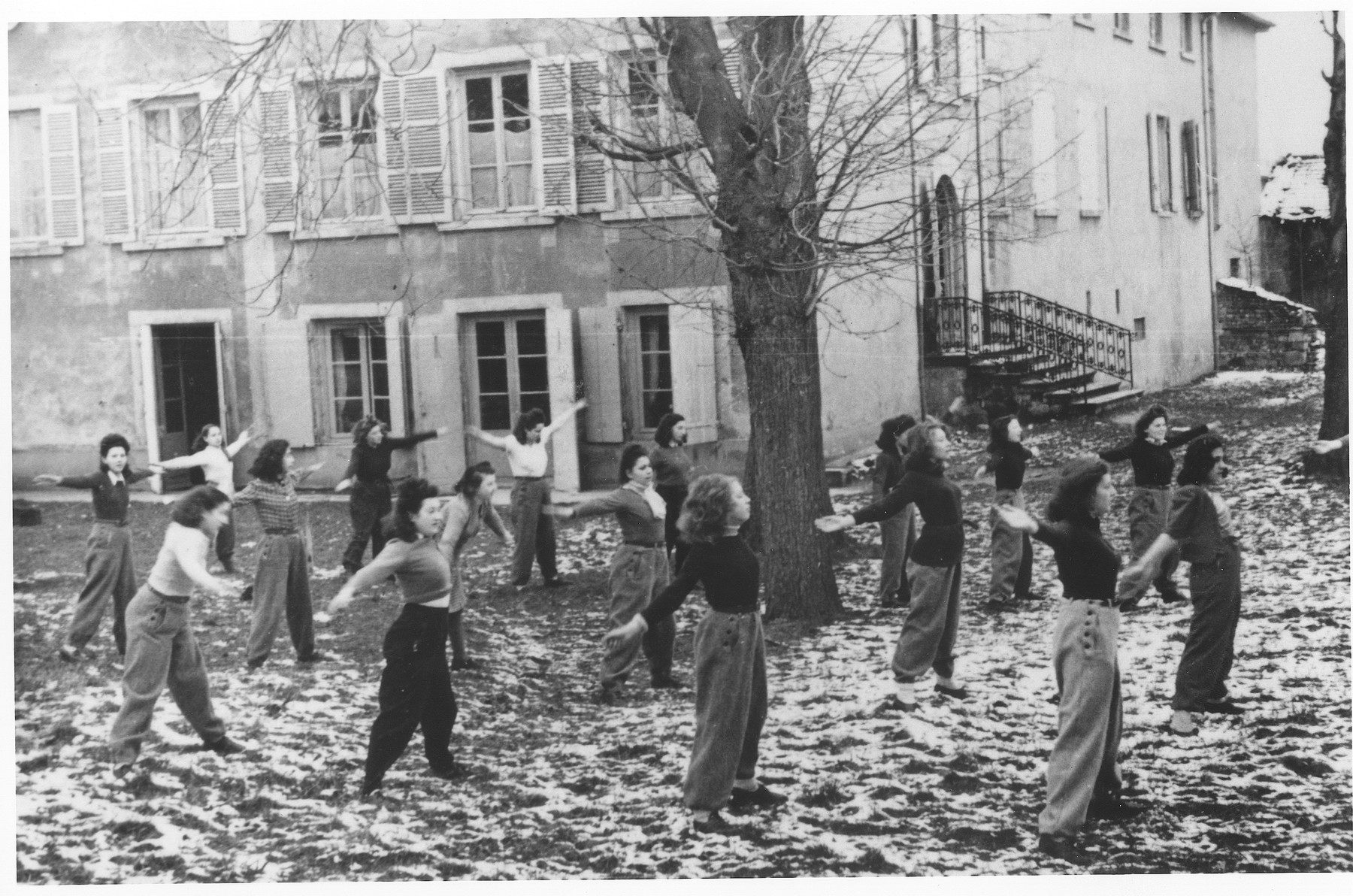 Girls exercise in the courtyard of the St. Germain children's home.