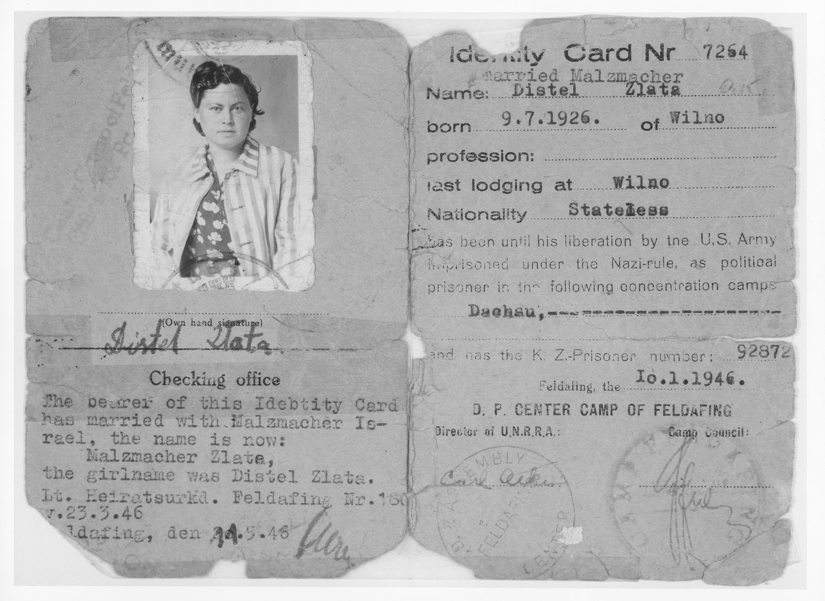 DP camp identification card issued to Zlata Distel at the Feldafing displaced persons camp.    In her ID photo the young woman is wearing the jacket of her concentration camp uniform.