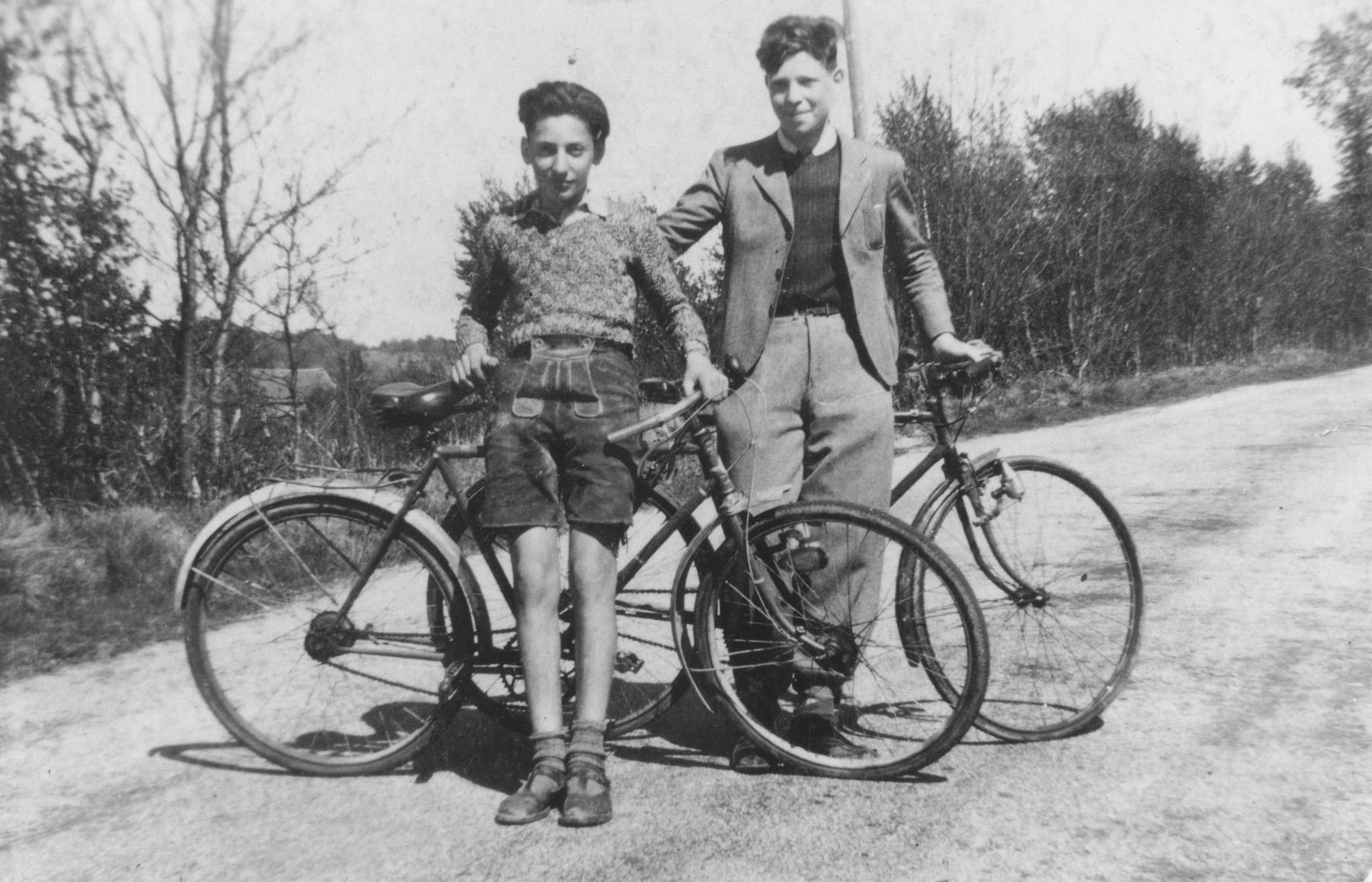 Two Jewish boys stand with their bicycles near the OSE (Oeuvre de Secours aux Enfants) children's home at the Château Masgelier.    Kurt Leuchter is pictured on the left, and Pierre Ickowitz is on the right.