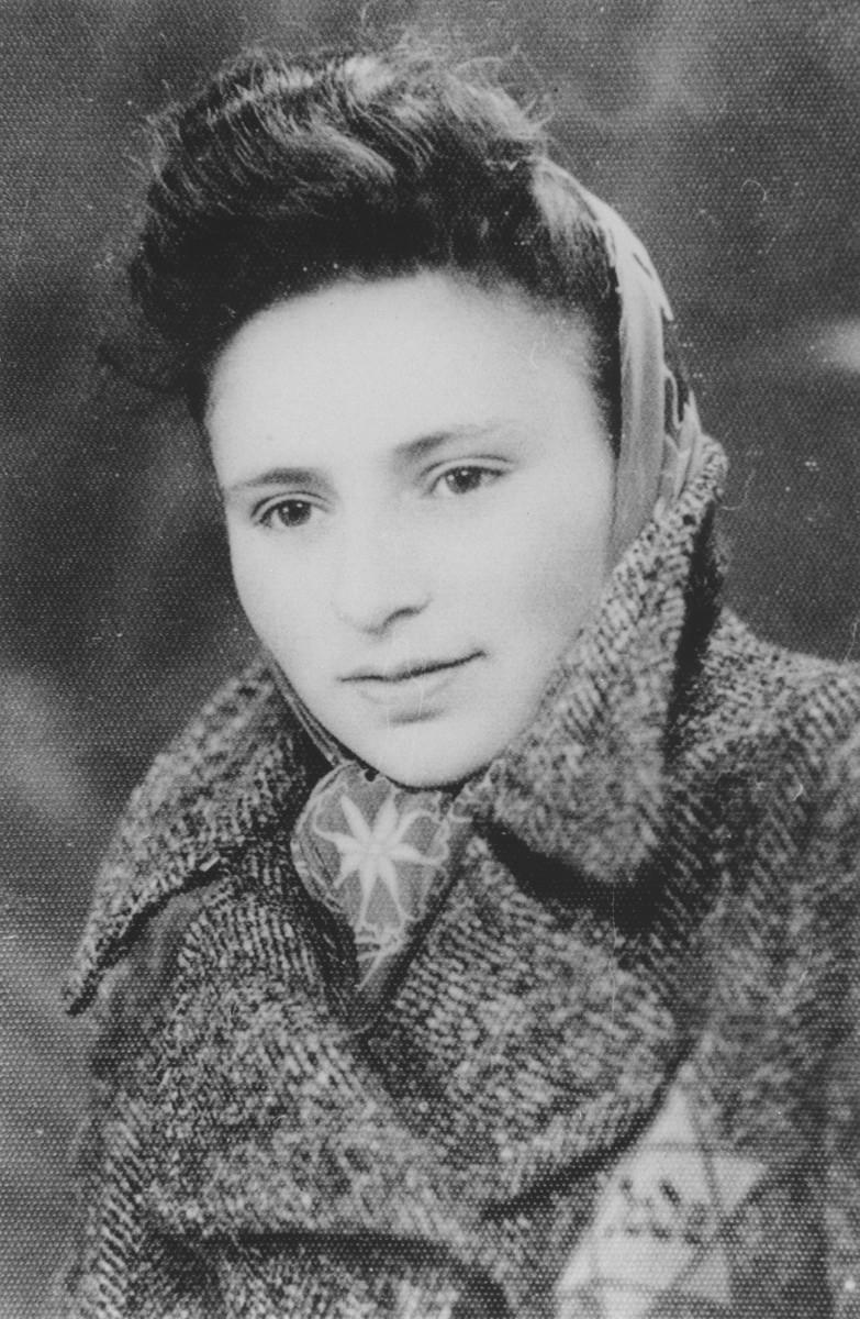Portrait of Lola (Slomnicki) Gottlieb wearing a Jewish star in the Dabrowa ghetto.
