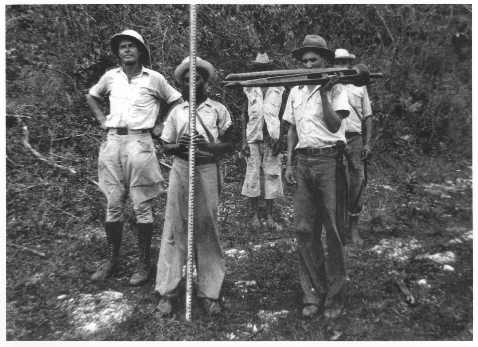 Felix Koch (left) and his workers prepare to drill in the forests near Sosua.