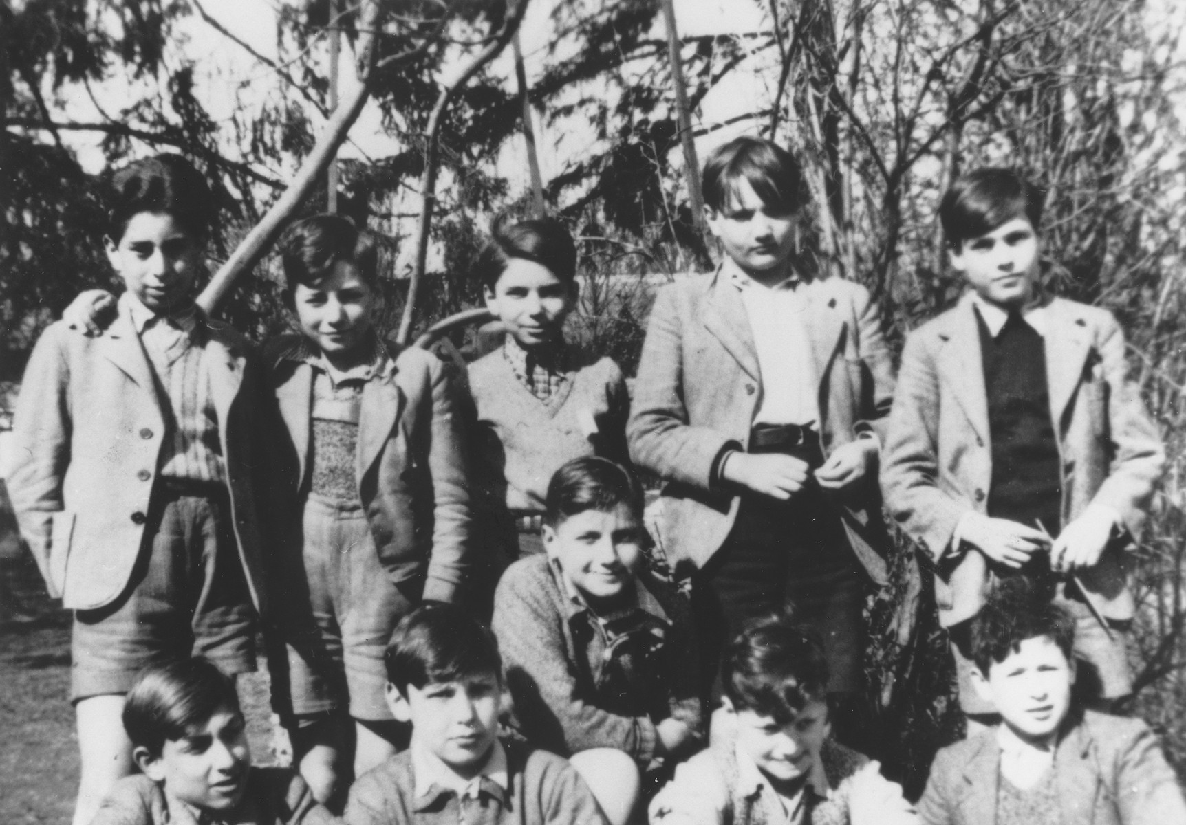 Group portrait of Jewish refugee boys who came to France on a Kindertransport from Germany.  Pictured in the front row, from left to right, are: Sali Obernicker, Hörst Wolff, Henry Rettig, Ivan Rose, and Hörst Cahn.  In the second row are Adi Kimmelfeld, Hans Stern, Pierre Marcuse, Gert Alexander and Siegfried Knop.