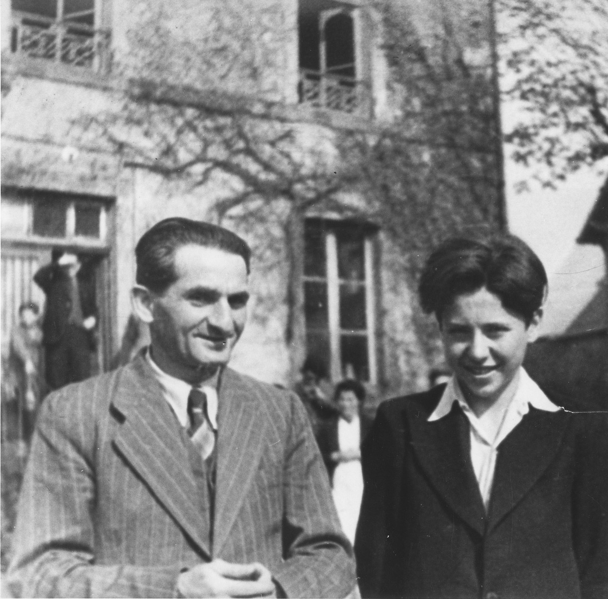 Ernst König (left) poses with Stephan Lewy (right) outside the Chabannes children's home.    König was the instructor in leather making at the home.