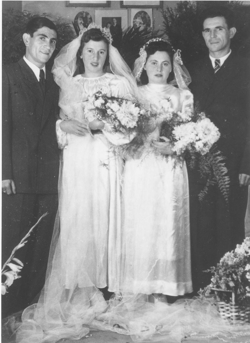 Double wedding portrait of Israel and Zlata (Distel) Malcmacher (right) and Motel and Lola (Rolnik) Malcmacher (left).