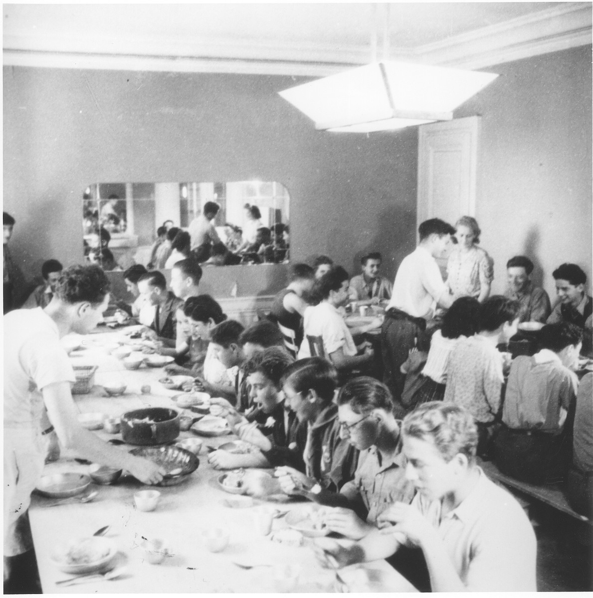Boys eat dinner in the communal dining hall of the Collonges children's home.
