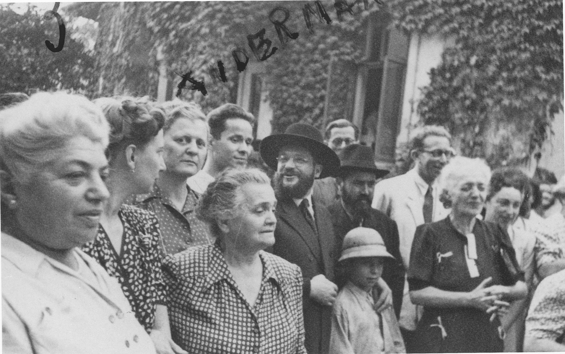 Romanian Jews celebrate the return of the surviving orphans of the camps and ghettos in Transnistria at an orphanage in Bucharest, where some of the children are being housed.   Among those pictured are Amy (Hubner) Andermann (third from the left in the second row) and Romanian chief rabbi Alexander Safran (center).