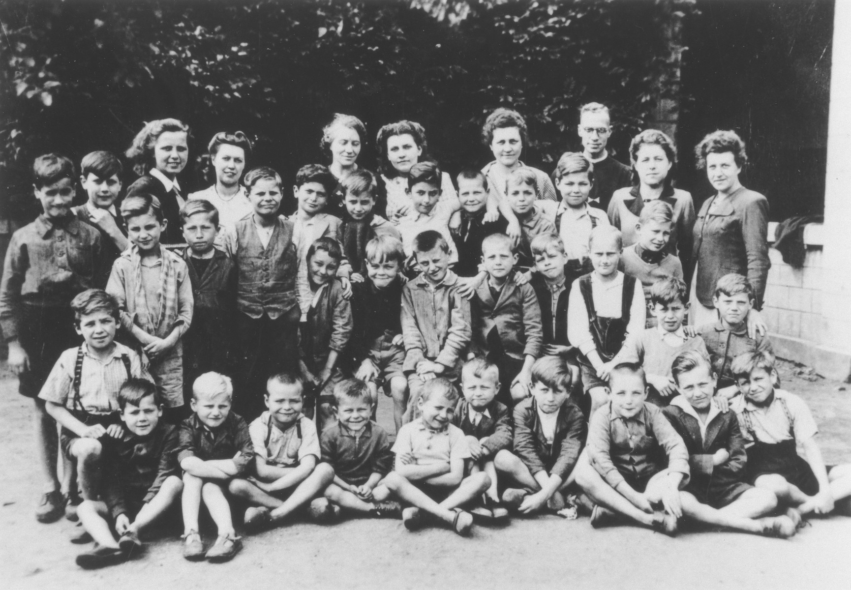 Group portrait of students and teachers at the Saint Jan Berchmans convent school in Maaseik.  Among those pictured are Jack Goldstein (third row from the bottom, right side) and his twin brother Bruno (in front of Jack), who are living in hiding at the convent.