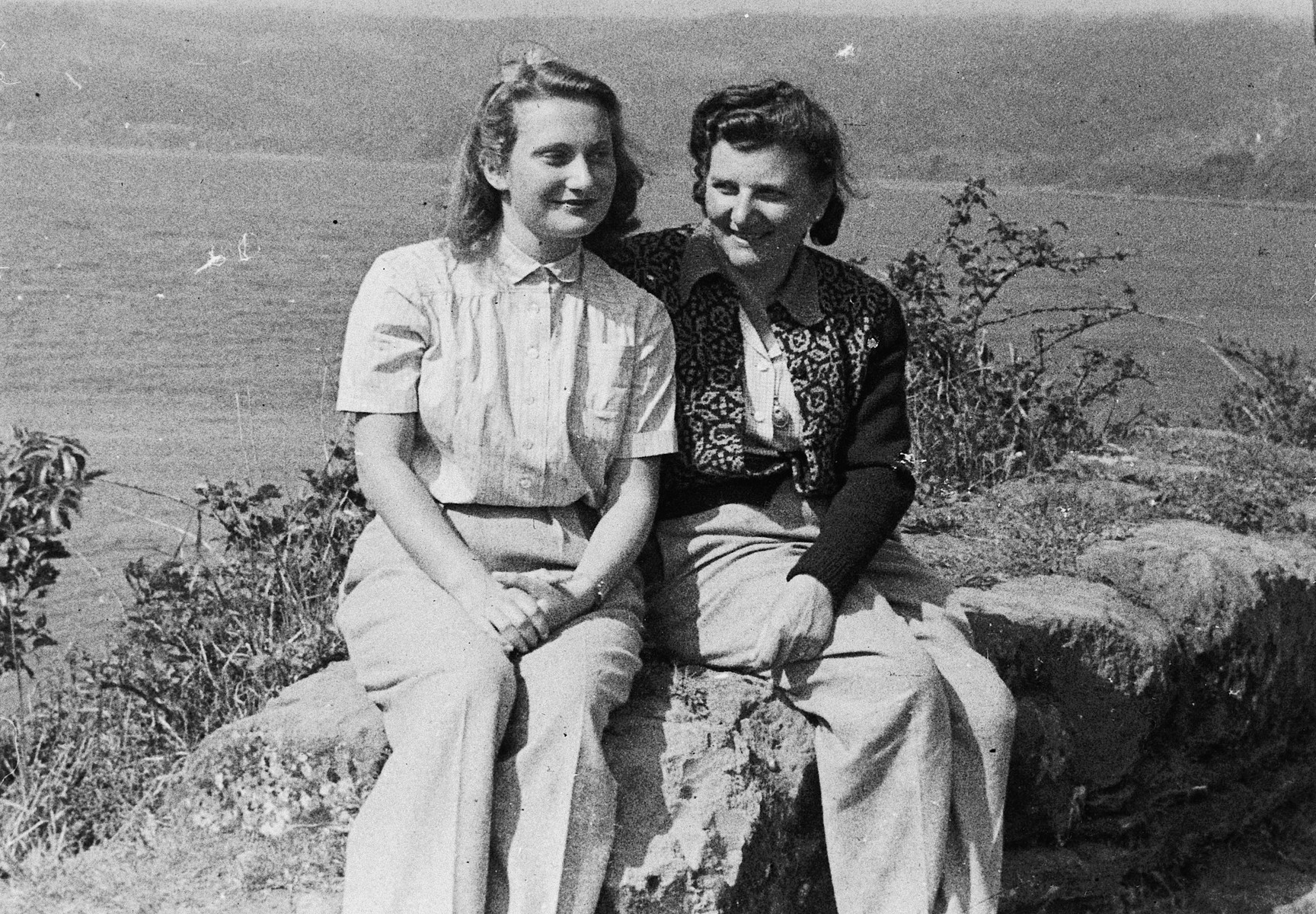 A mother and daughter, recent immigrants to Chile and survivors of Nazi concentration camps, pose outdoors together.  Pictured are Katerina Margolius and Ines Margolius Renner.