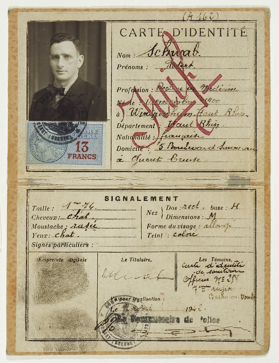 "Identity card issued to Dr. Robert Schwab stamped ""Juif"" (Jew) is large red letters."