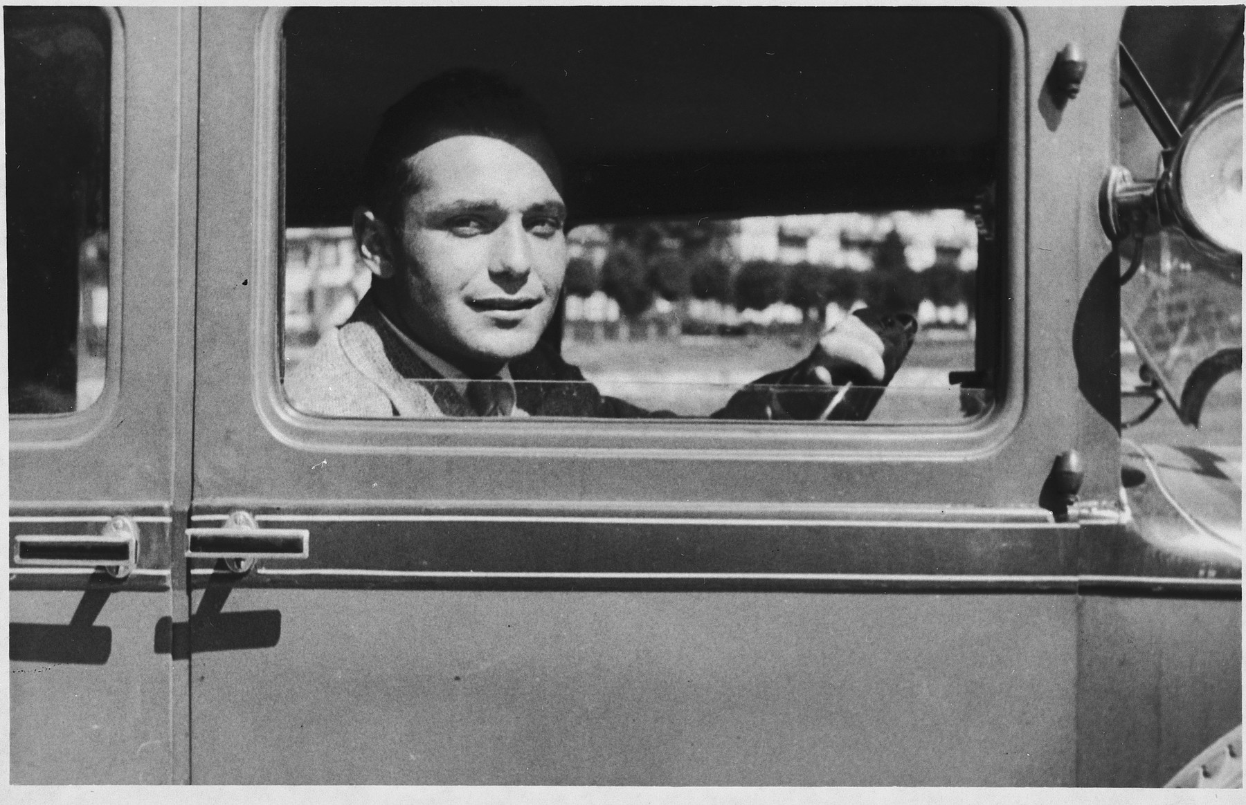 Portrait of Jewish athlete, Ota Margolius, looking out the window of an automobile.