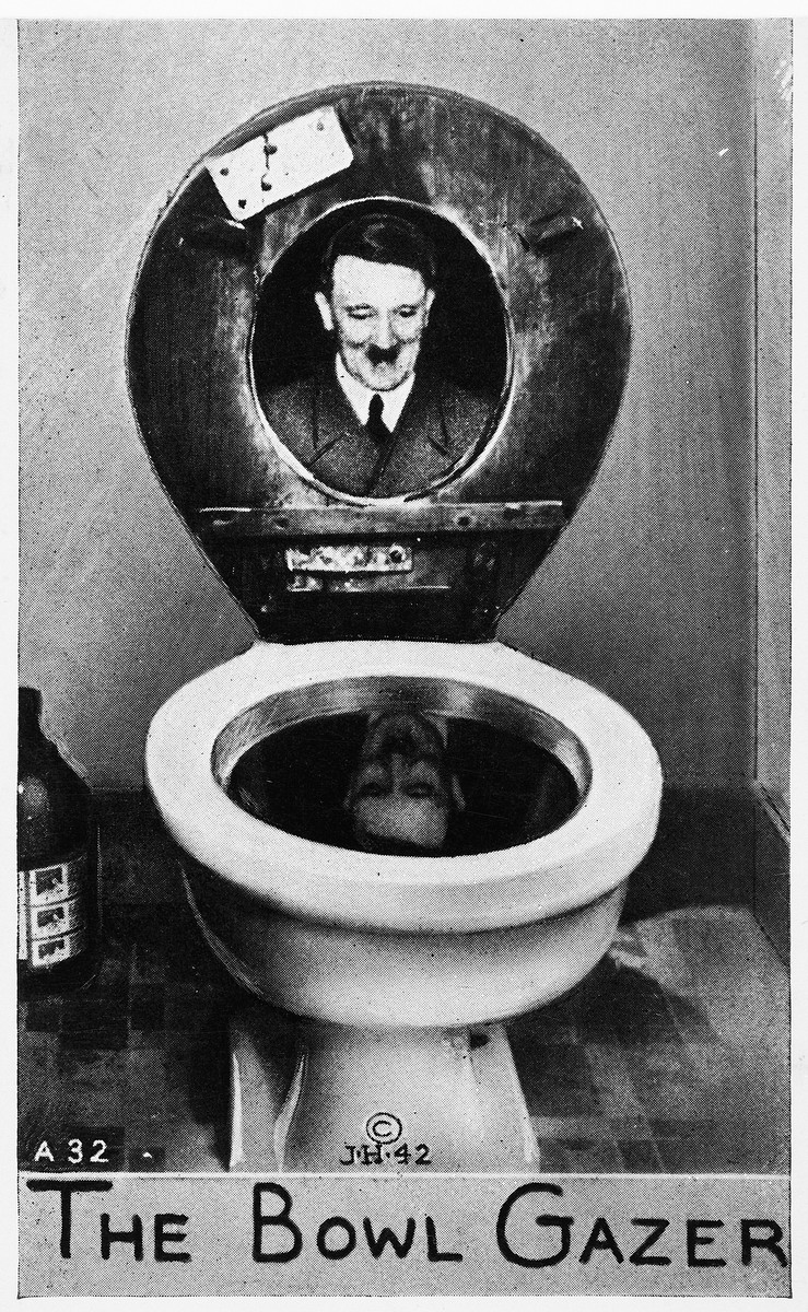 """Satirical postcard entitled """"The Bowl Gazer,"""" featuring Adolf Hitler looking at his reflection in a toilet bowl, signed J.H. 42."""