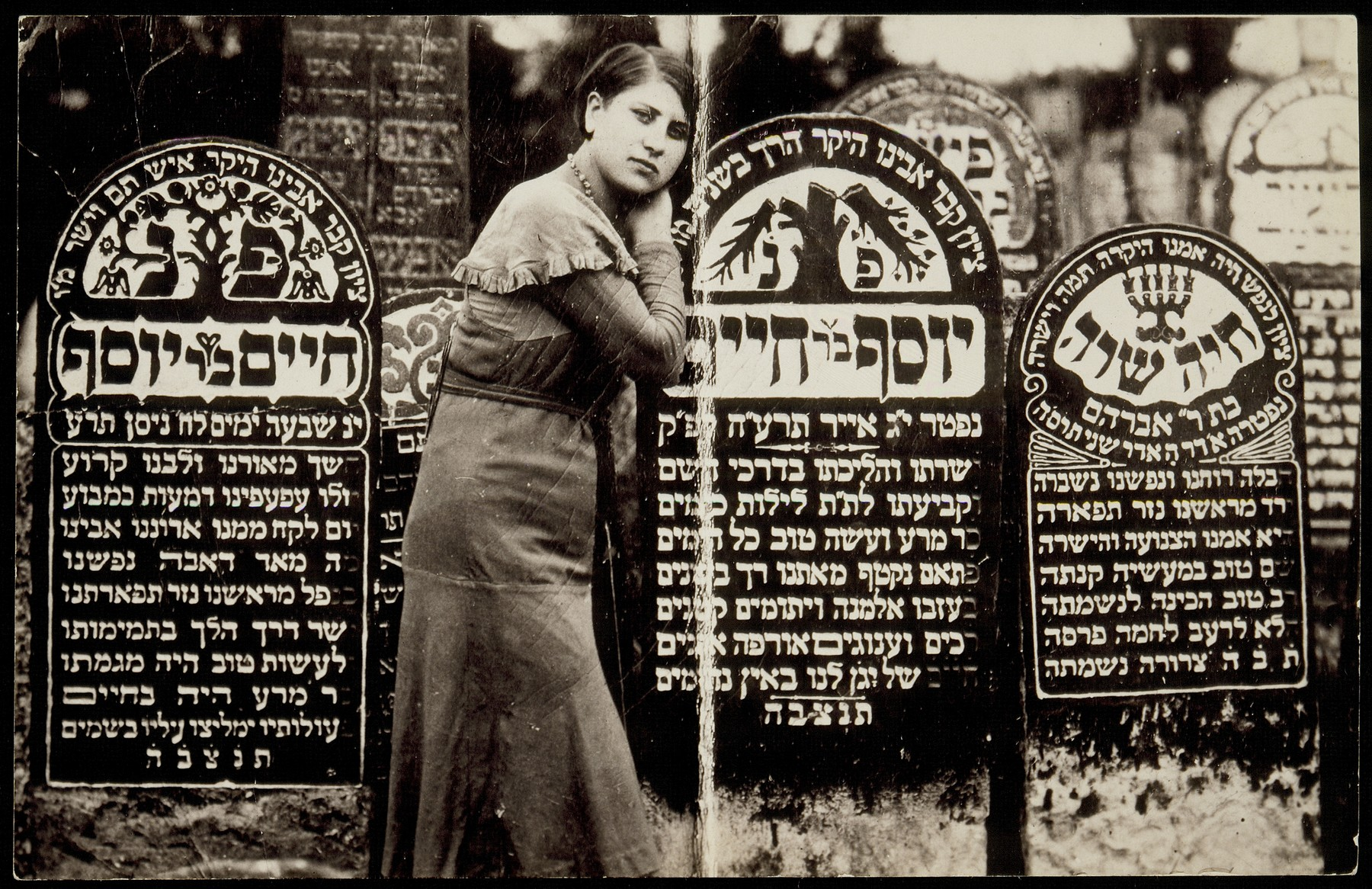 Rivka Shuster stands at the grave of her father Joseph who died in 1915.   On her right is the grave of her grandfather Hayyim Shuster, who died in 1910.  Rivka survived the Holocaust in hiding with her son Joseph who was born on January 31, 1943 in the forest