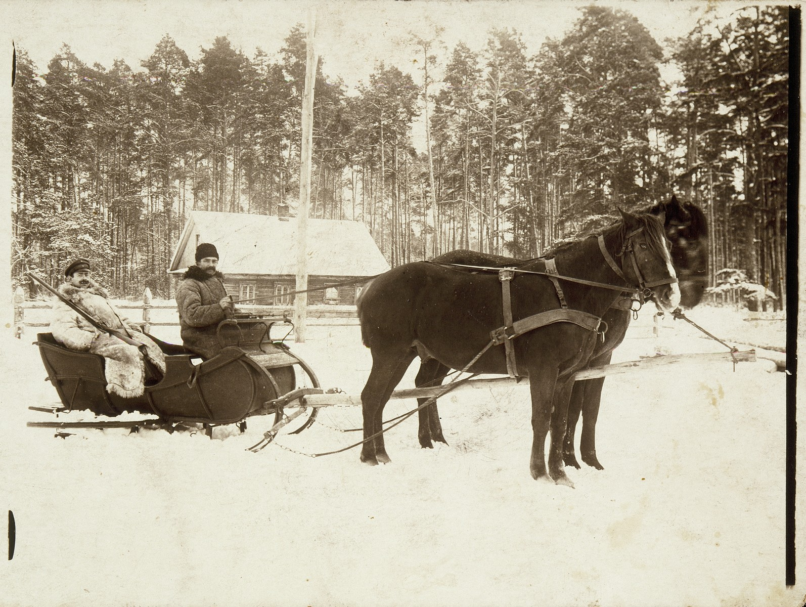 A Jewish coachman drives Varishnakov, a high ranking Russian officer, on a sleigh to a hunt.    The coachman was murdered in the September 1941 massacre.