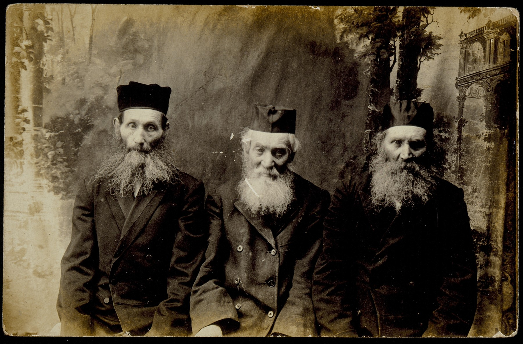 Avigdor Dwilanski (center) with his two brothers Rabbi Moshe-Leib Krisilov (left) and Rabbi Kosolewicz (first name unknown).   Each brother had taken a different name in order to avoid service in the tzarist army.  Reb Avigdor studied at the Volozhin yeshivah and was an accomplished scholar, but supported himself as a baker.