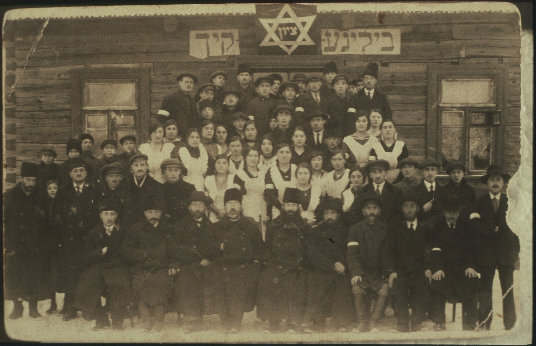 Staff of the soup kitchen in Eisiskes.  The soup kitchen was established during World War I to prevent large-scale starvation and served both Jews and non-Jews.  It also was the town's first coed voluntary society.  Among those pictured are Meir Kiuchefski, Maneh Michalowski, the Lewinson sisters, Zivia Hutner, and members of the Sonenson, Abelowicz and Schneider families.