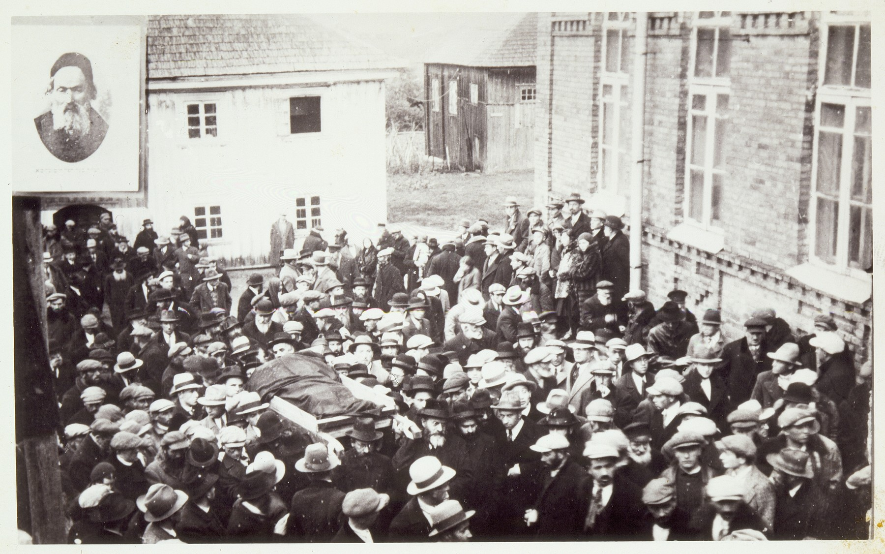 A large crowd of disciples gathers at the Radun Yeshiva to escort the body of the Hafetz Hayyim during his funeral.